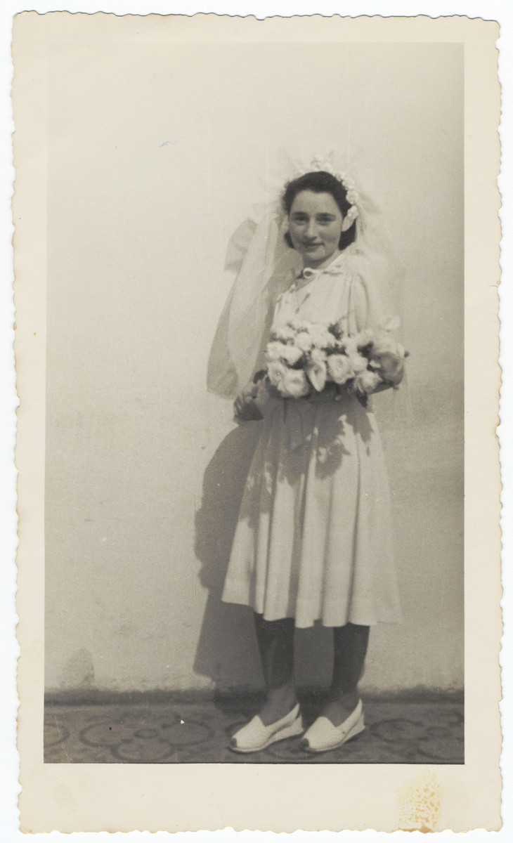 Close-up portrait of a bride holding her bridal bouquet.  Pictured is Miriam Domawaska Fischer.