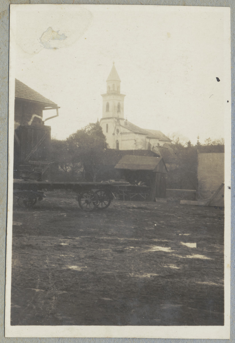 View of a flat-bed cart parked in a muddy public square in Berehovo.