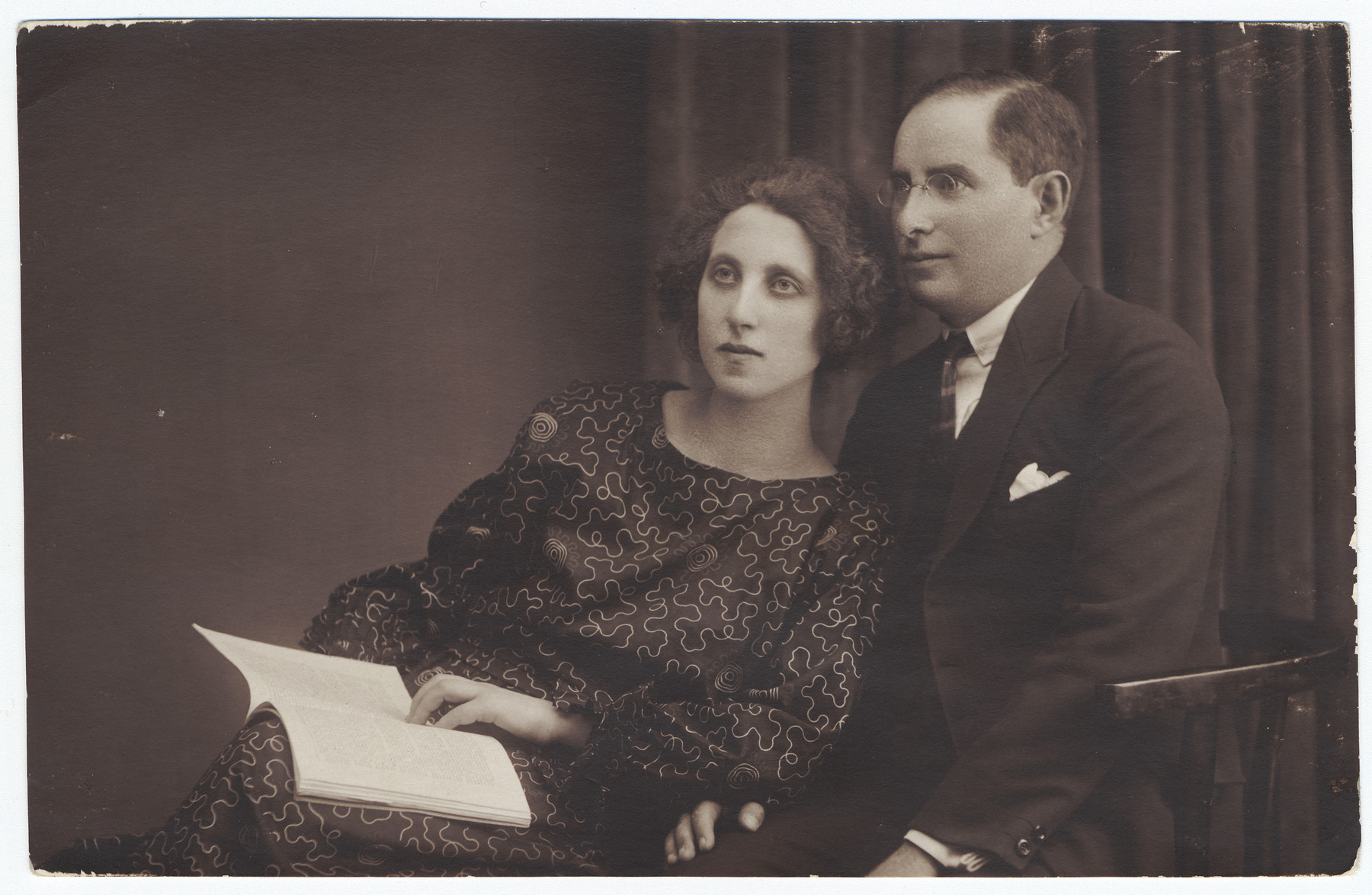 Studio portrait of a Romanian-Jewish couple.  Pictured are Ephraim and Dolly Neuman.