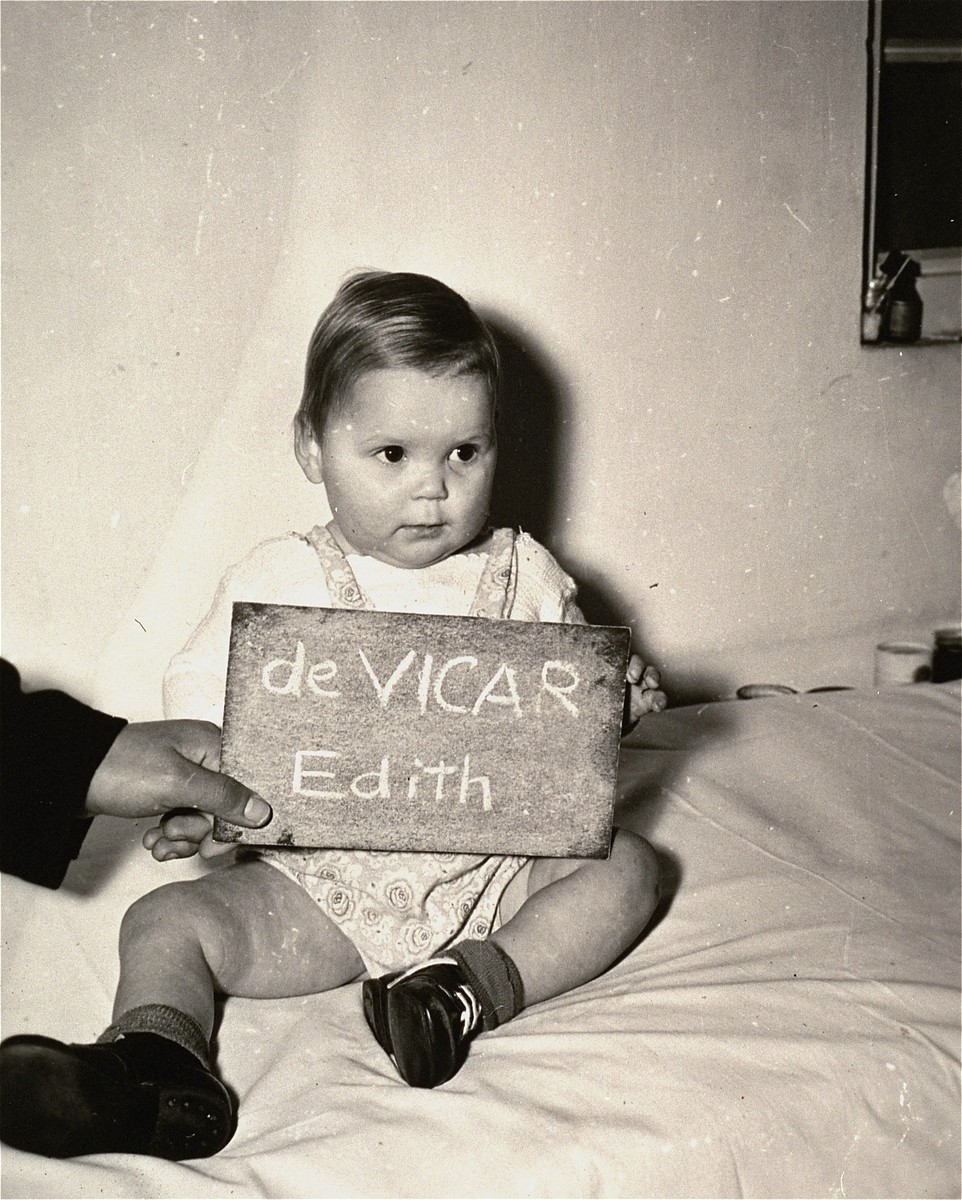 Edith de Vicar with a name card intended to help any of her surviving family members locate her at the Kloster Indersdorf DP camp.  This photograph was published in newspapers to facilitate reuniting the family.