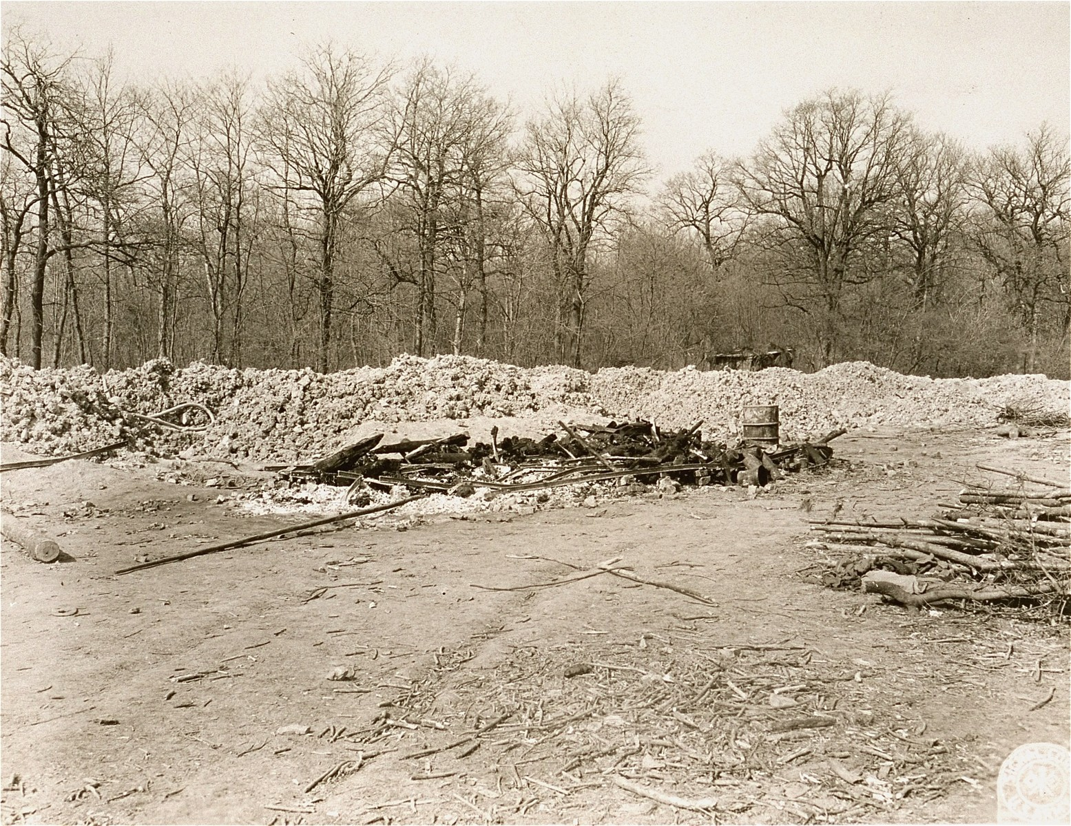 The remains of an open pyre where bodies exhumed from a mass grave were burned prior to the arrival of American forces at Ohrdruf.