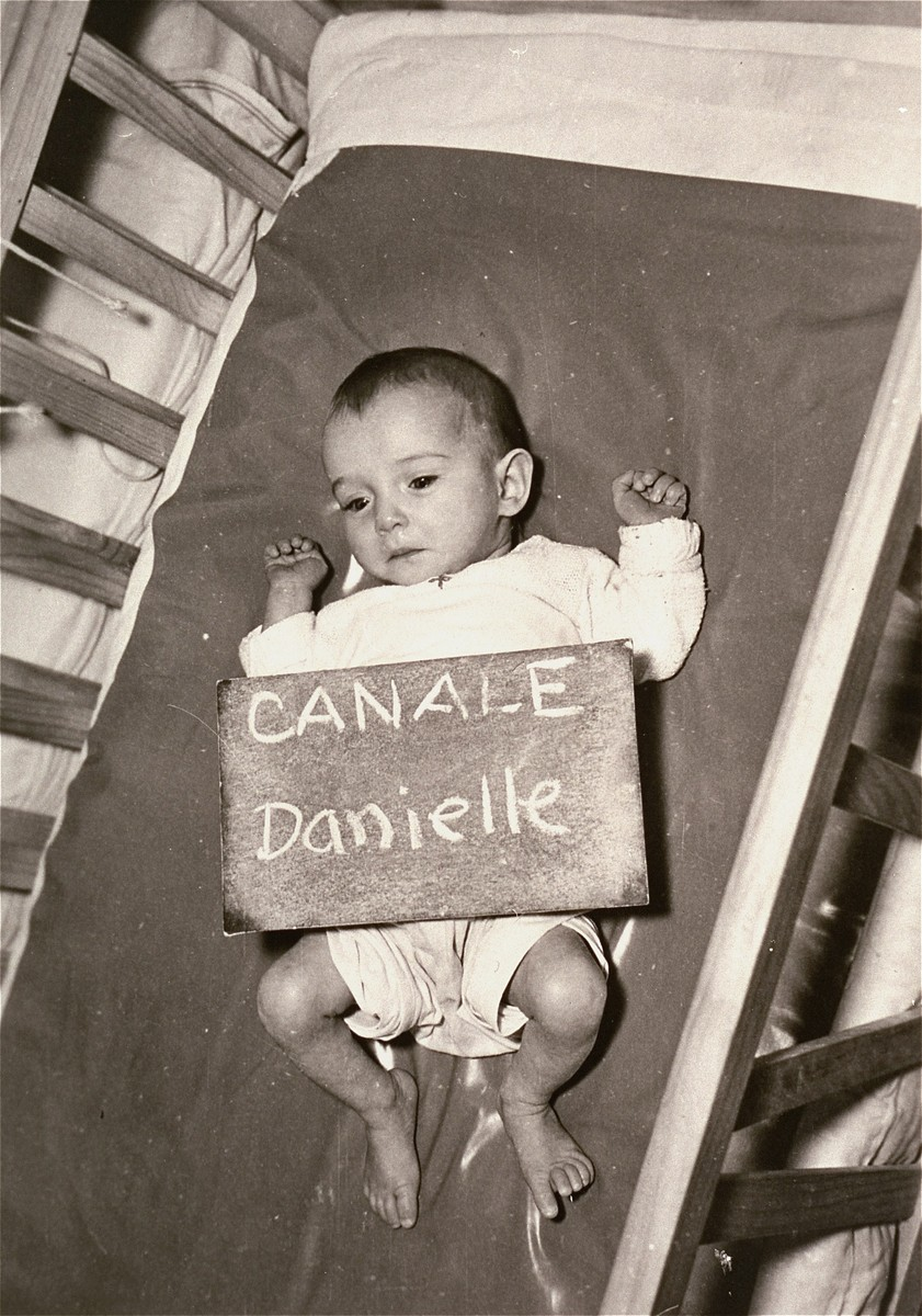 Danielle Canale with a sign card intended to help any of her family members locate her at the Kloster Indersdorf DP camp.  This photograph was published in newspapers to facilitate reuniting the family.
