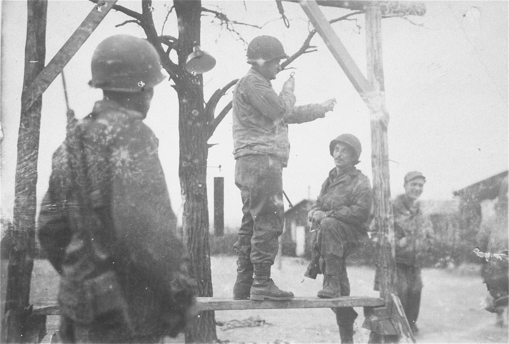 American soldiers examine a gallows on which prisoners were publicly hanged in the Ohrdruf concentration camp.