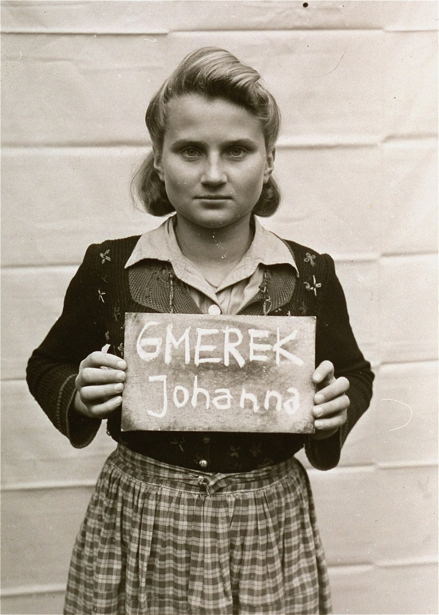 Johanna Gmerek holds a name card intended to help any of her surviving family members locate her at the Kloster Indersdorf DP camp.  This photograph was published in newspapers to facilitate reuniting the family.   She was from Upper Silesia.  Their German teacher brought her class to Bavaria to escape Soviet troops.