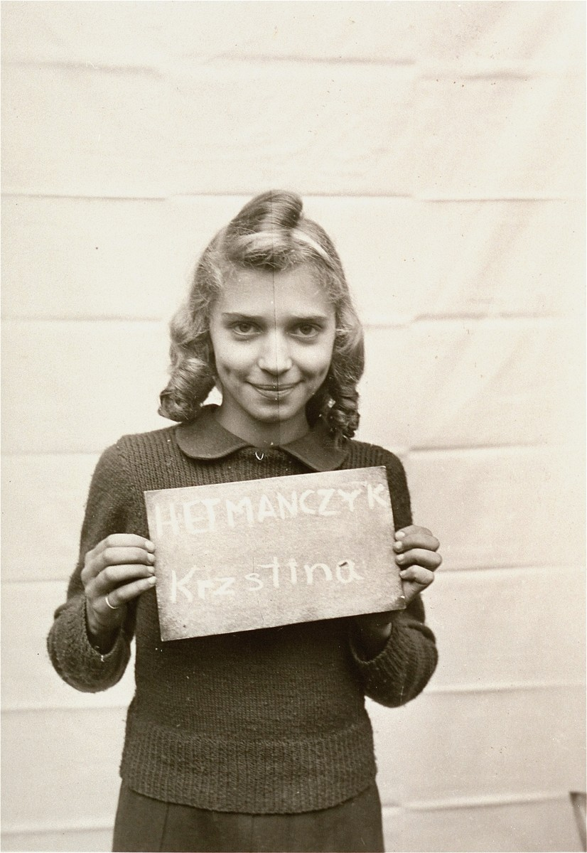 Krzstina Hetmanczyk holds a name card intended to help any of her surviving family members locate her at the Kloster Indersdorf DP camp.  This photograph was published in newspapers to facilitate reuniting the family.