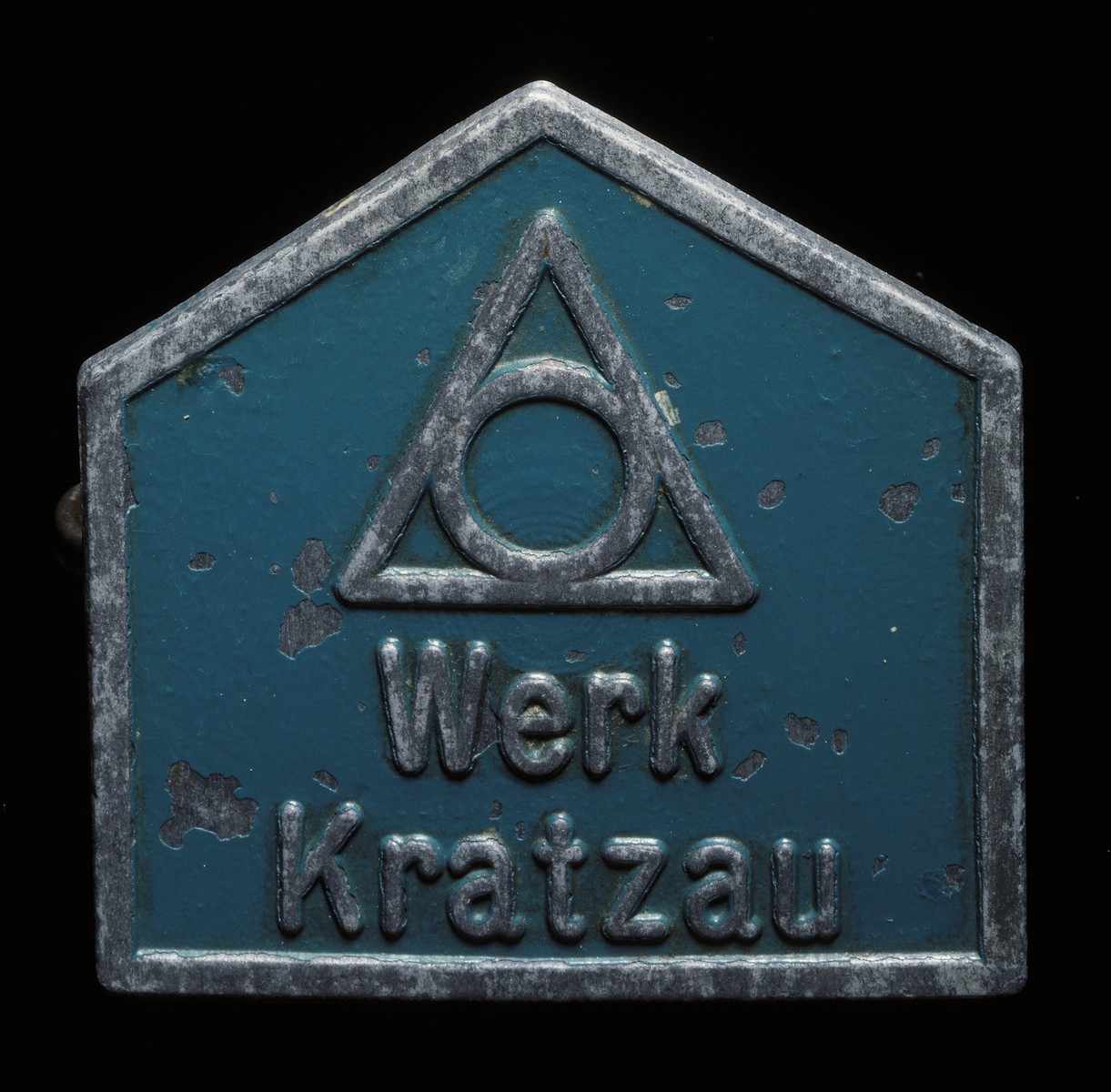 Five-sided badge issued to Helen Waterford identifying her as a prisoner from the Kratzau-Chrastava labor camp, a satellite camp of Gross Rosen.  Waterford was interned at the camp from October 1944 to May 1945.