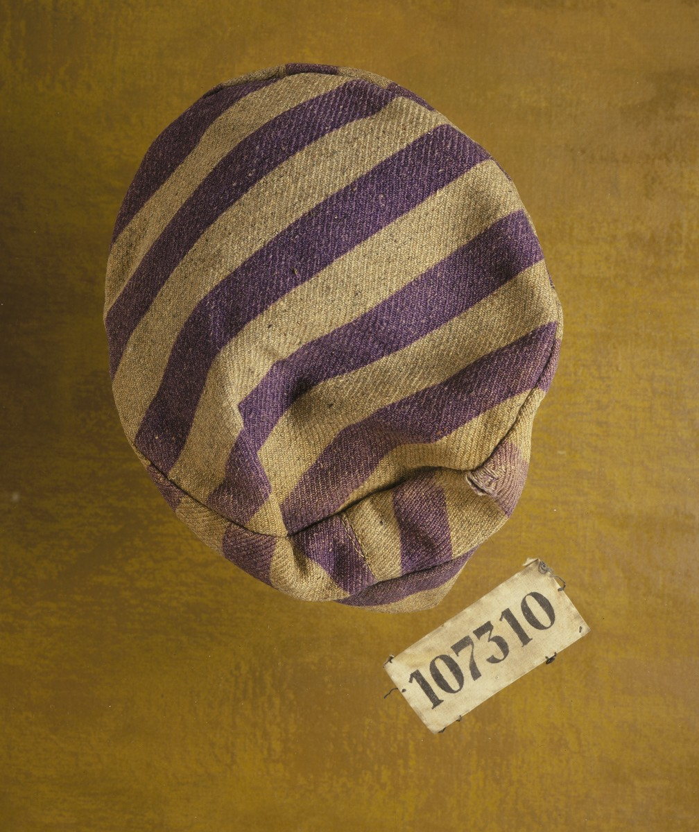 The cap of a prison uniform and a number patch worn by concentration camp prisoner Karel Bruml at Auschwitz and Nordhausen.  Both were issued to him in Auschwitz.