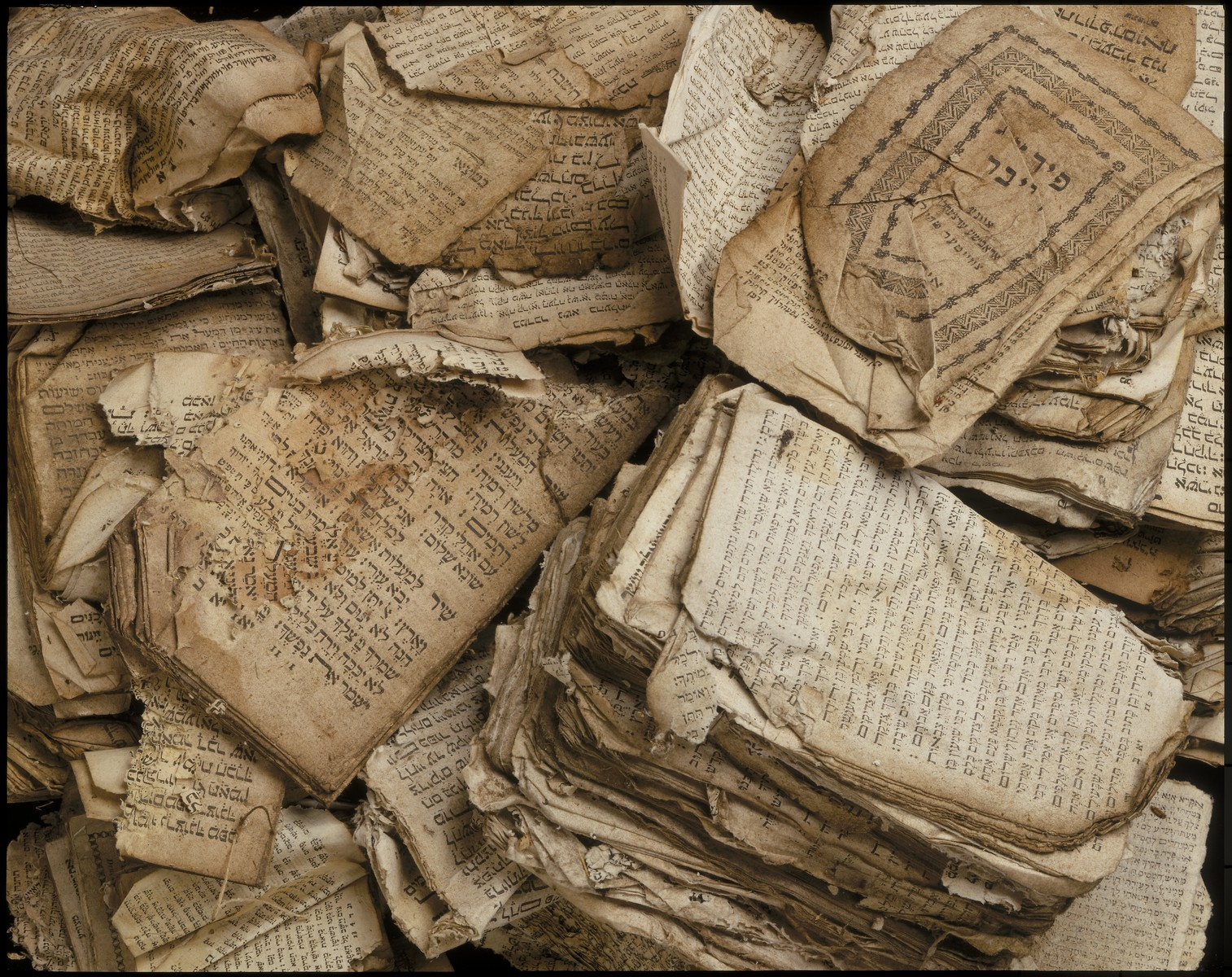 A pile of Hebrew prayerbooks and other Jewish religious texts damaged by fire at the synagogue in Bobenhausen II, District Vogelsberg, during Kristallnacht.