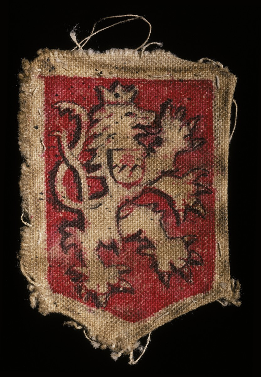 Cloth patch depicting a shield with the heraldic image of the rampant lion of Czechoslovakia.