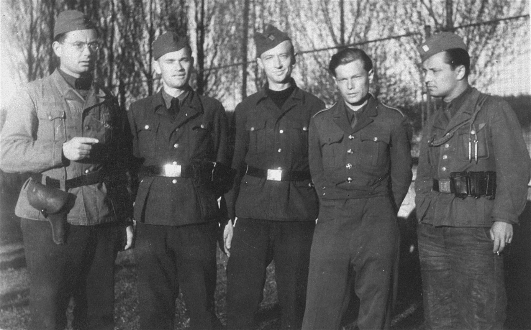 Group portrait of survivors of Auschwitz, Dachau, and Gross Rosen who were drafted into the Czech army right after the war.    Among those pictured is Franta Kohn (right).