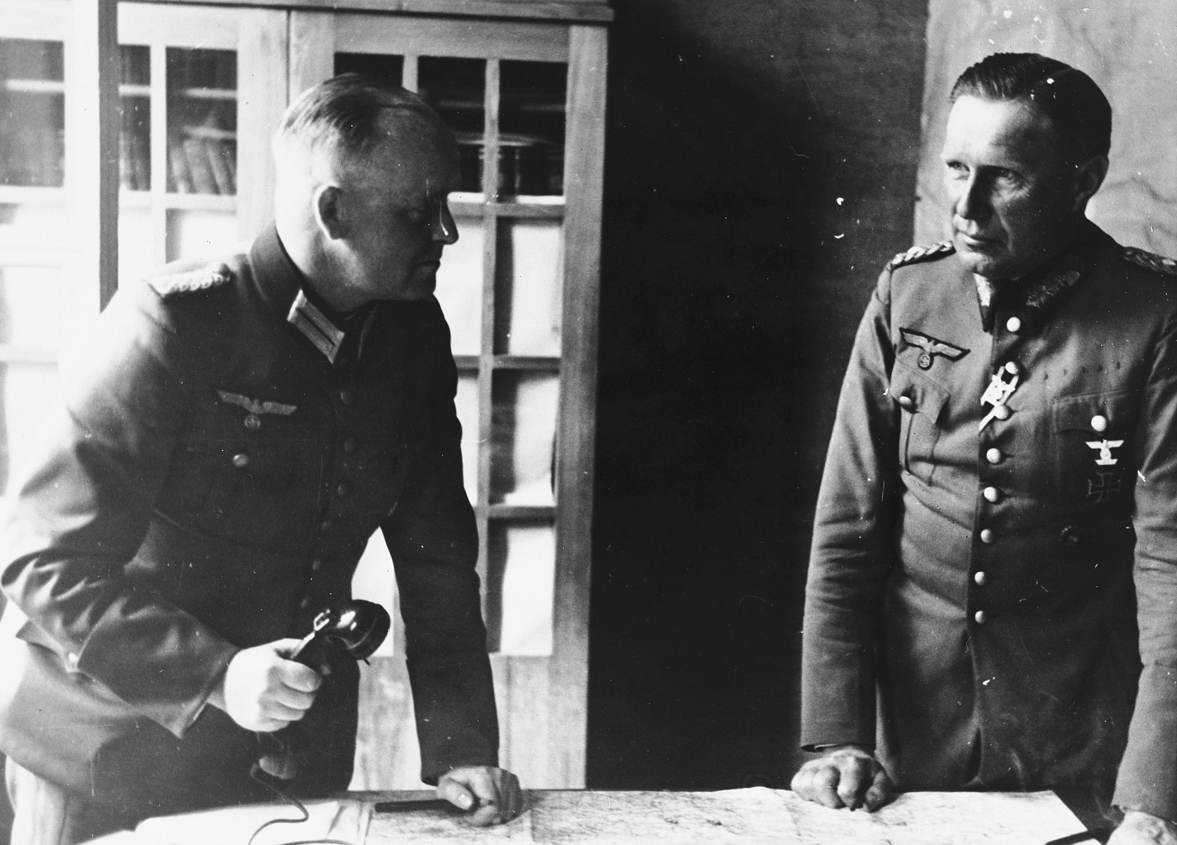 Close-up portrait of two German officers in their headquarters [probably in the Soviet Union].