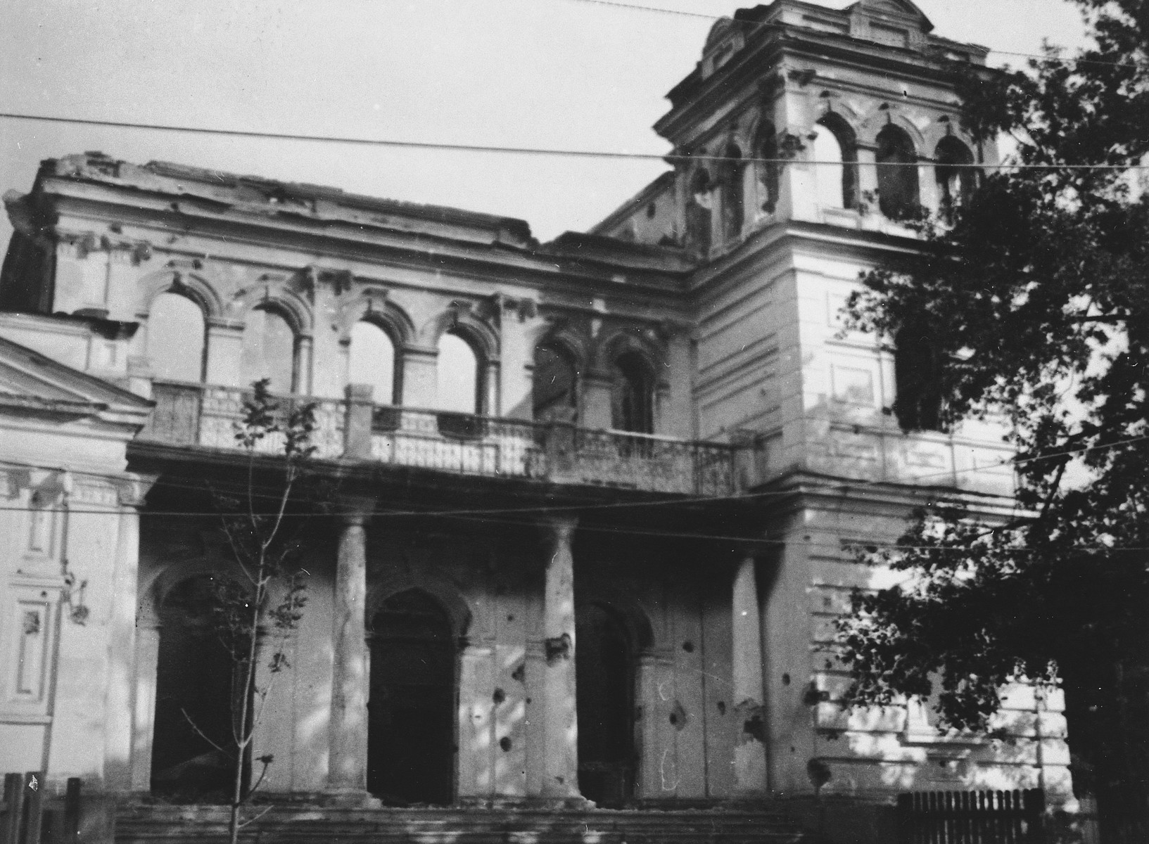 Exterior view of a large war-damaged building in the Warsaw ghetto.