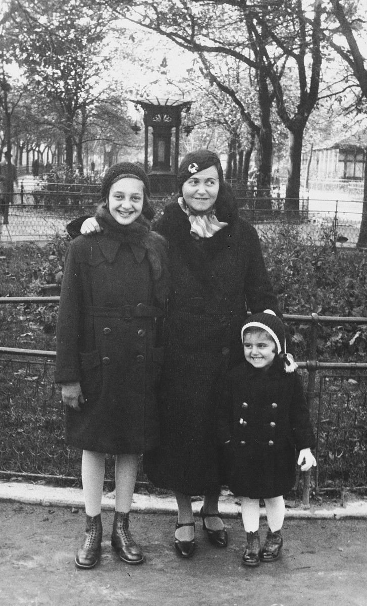 Kitty Weichherz poses with her mother and her older cousin, Klari Neumann, in a park [probably in Bratislava].  This photo was taken from the diary of Kitty's life written by her father, Bela Weichherz.
