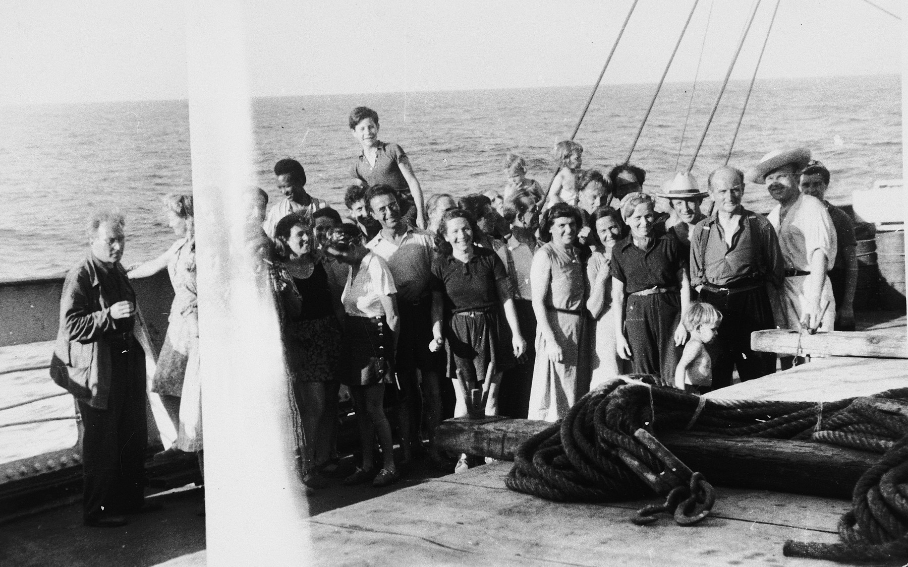 Group portrait of European refugees saved by the Emergency Rescue Committee on board the Paul-Lemerle, a converted cargo ship sailing from Marseilles to Martinique.  Among those pictured are: Victor Serge, Jacqueline Lamba Breton, Midi Branton, Mrs. Lam, Wifredo Lam, Katrin Kirschmann, Dyno Lowenstein, Harry Branton, Carola Osner, Walter Barth (in background holding a child), Ate Barth, Karl Osner (carrying his daughter on his shoulder), Emmy Orsech-Bloch, Erika Giepen, Margret Osner, Karl Langerhans, and Hubert Giepen.