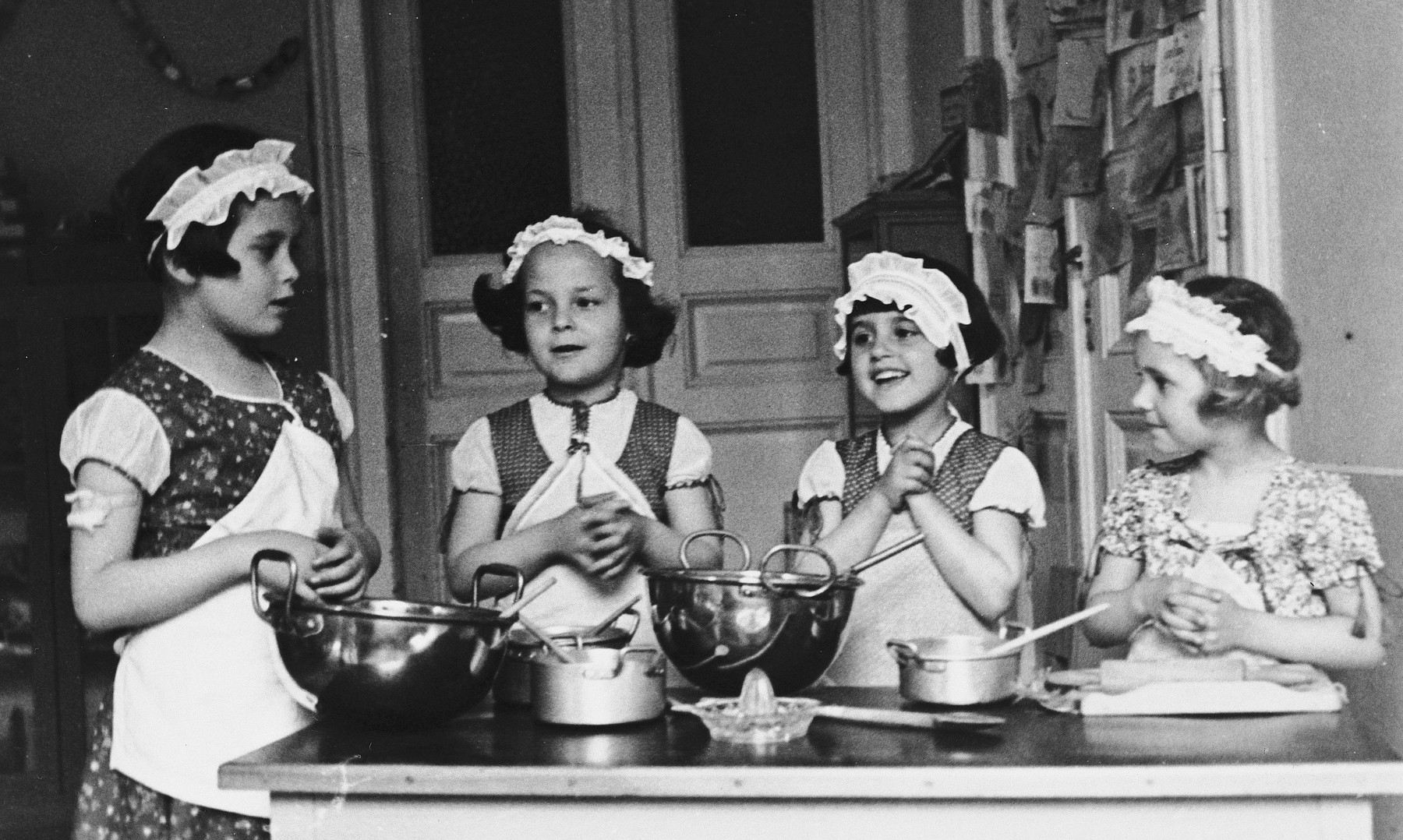 Kitty Weichherz and three friends practice cooking.  Kitty is pictured second from the right.  This photo was taken from the diary of Kitty's life written by her father, Bela Weichherz.