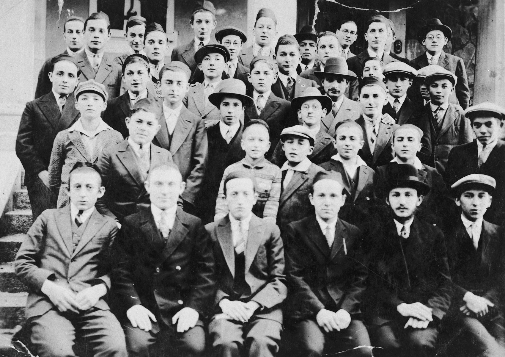 Group portrait of students in a Hungarian yeshiva.  Pictured in the top row is Josif Frankel.