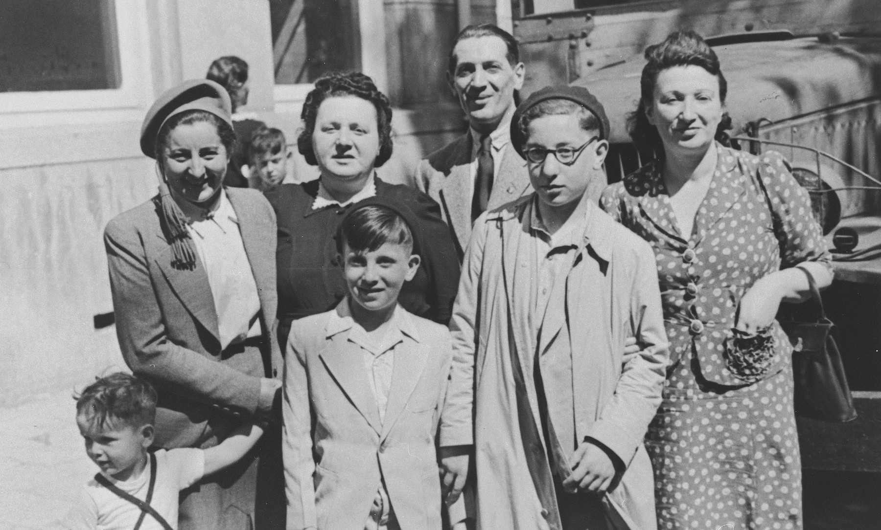 Two Dutch Jewish brothers pose with the woman who served as their surrogate mother in Theresienstadt and their cousins who cared for them after the war.  Standing in front are Charlie and Leo Sigmann.  Standing in back from left to right are Malka Weinman and her nephew (name unknown), Pepa and Yosef Berger, and Regina Felsen van Chelder.