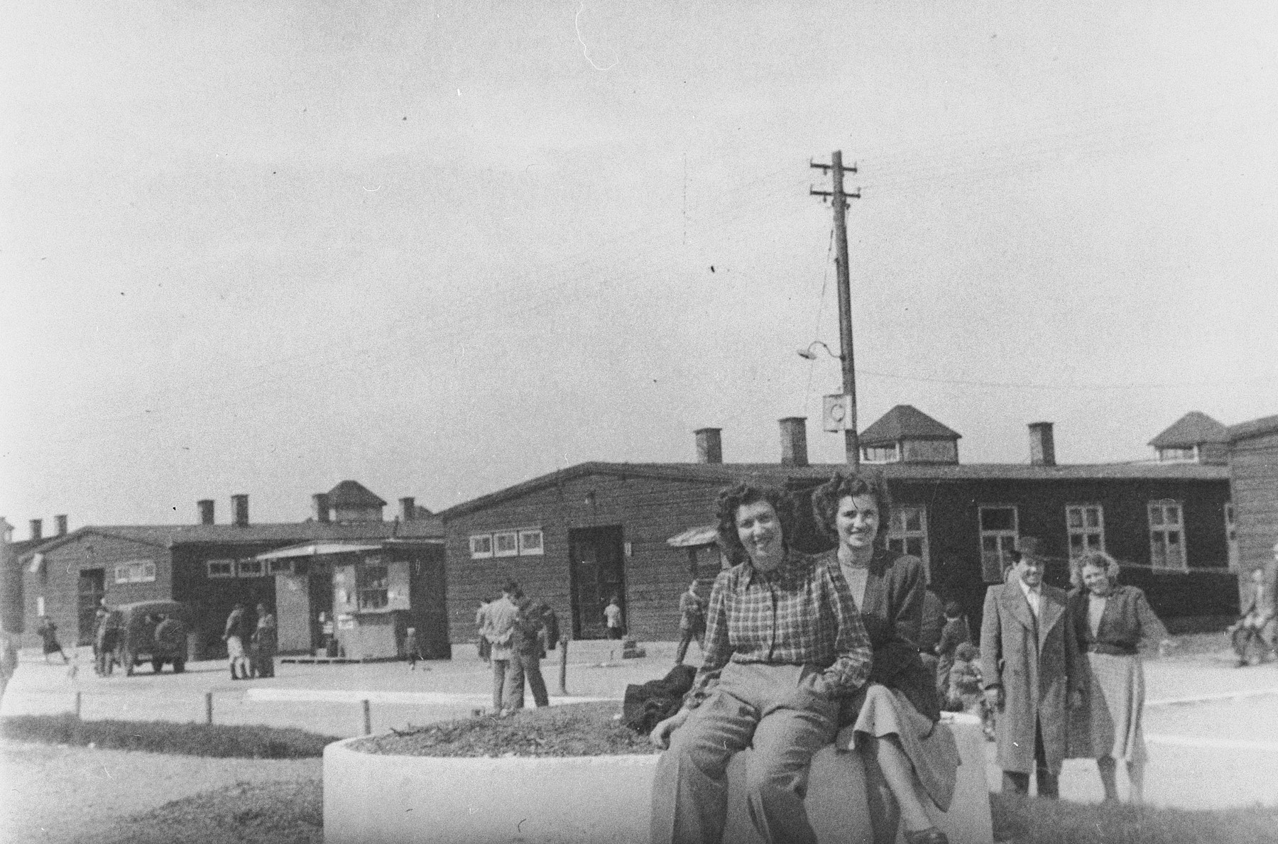 Jewish women pose outside the barracks in the Wels displaced persons' camp.
