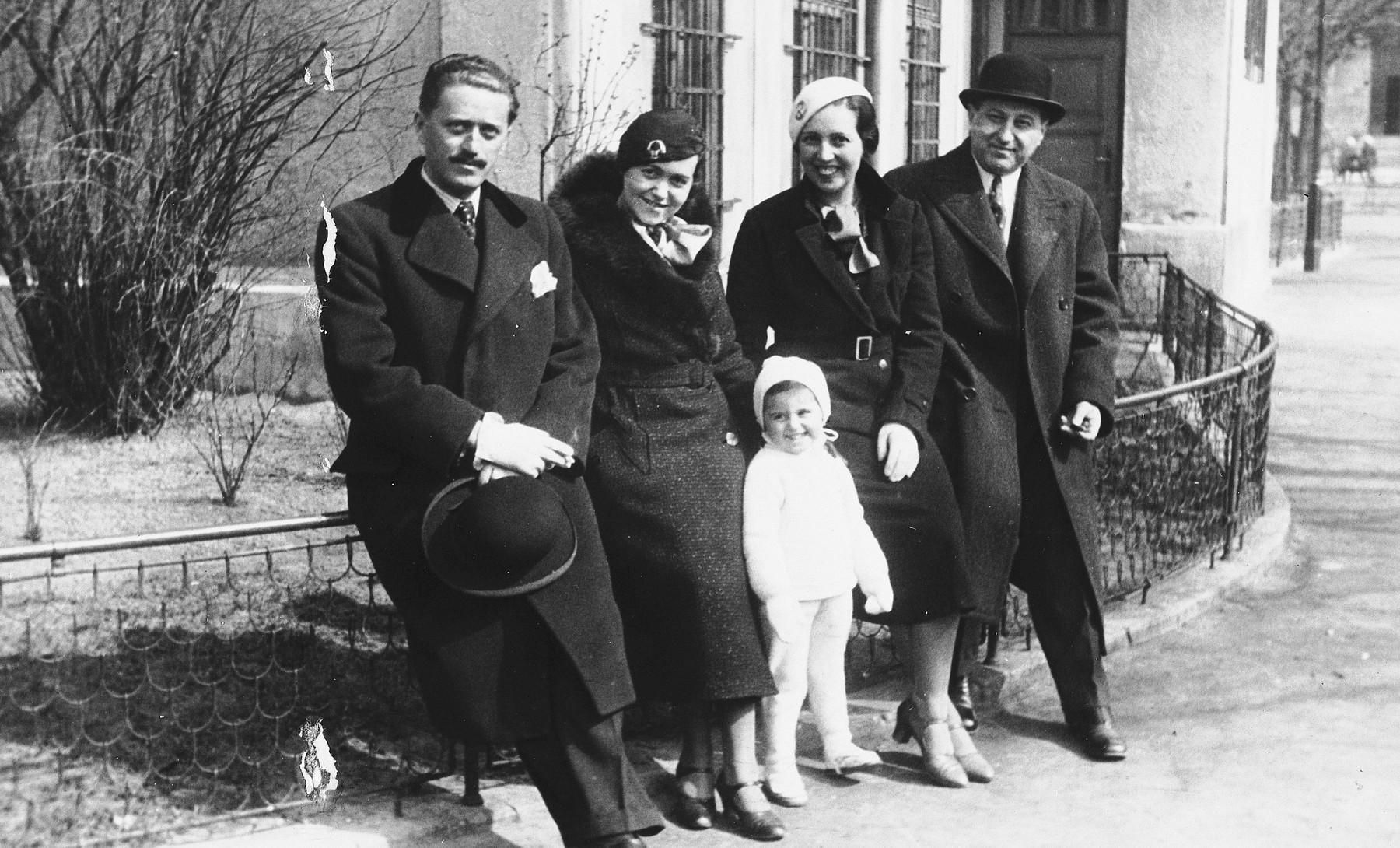 Portrait of the Weichherz family taken outside a building [probably in Bratislava].  From left to right: are Karol Ripper (a family friend in Bratislava who later died in the Holocaust), Esti Weichherz, Kitty Weichherz, Rudica Zoltan, (the wife of Bela`s brother Marcel who survived Ravensbrueck), and Bela Weichherz.  This photo was taken from the diary of Kitty's life written by her father, Bela Weichherz.