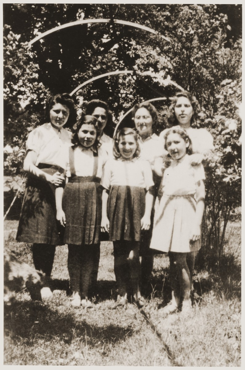 Group portrait of Jewish refugee children, who had been released from French internment camps, at the OSE [Oeuvre de secours aux enfants] home for religious girls at Le Couret.  Pictured are Lison Kleeman, Bertha, Marion, Lucie, Helene Klizman, Esther, Sophie, and Vicki Kahn.