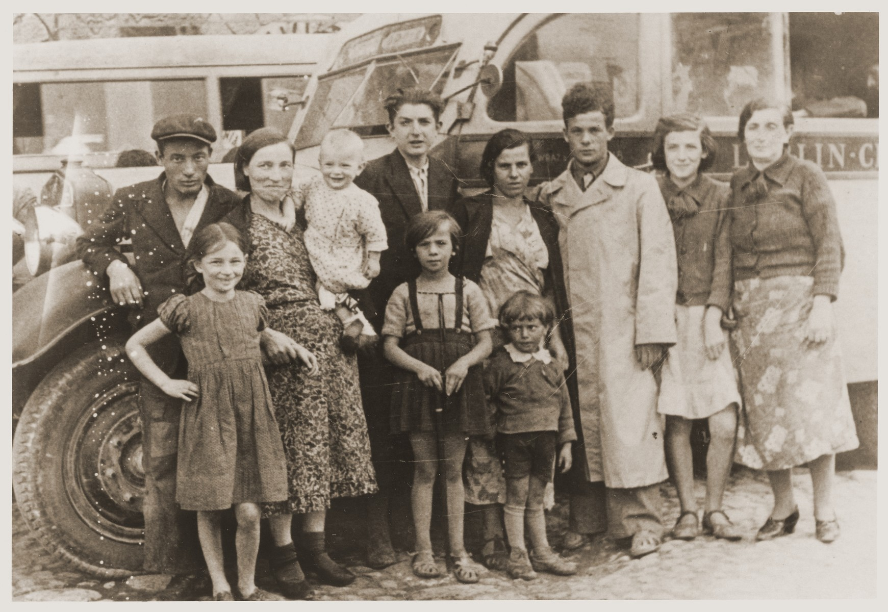 Members of the Tuchsznajder family pose in front of a bus during a vacation in Kazimierz.