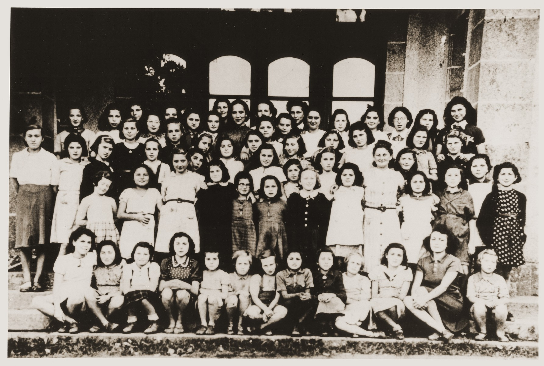 Group portrait of Jewish refugee children, who had been released from French internment camps, at the OSE [Oeuvre de secours aux enfants] home for religious girls at Le Couret.  Among those pictured is Beate Stern (front row, seventh from the left) and Margot Altman (first row, fourth from the left).