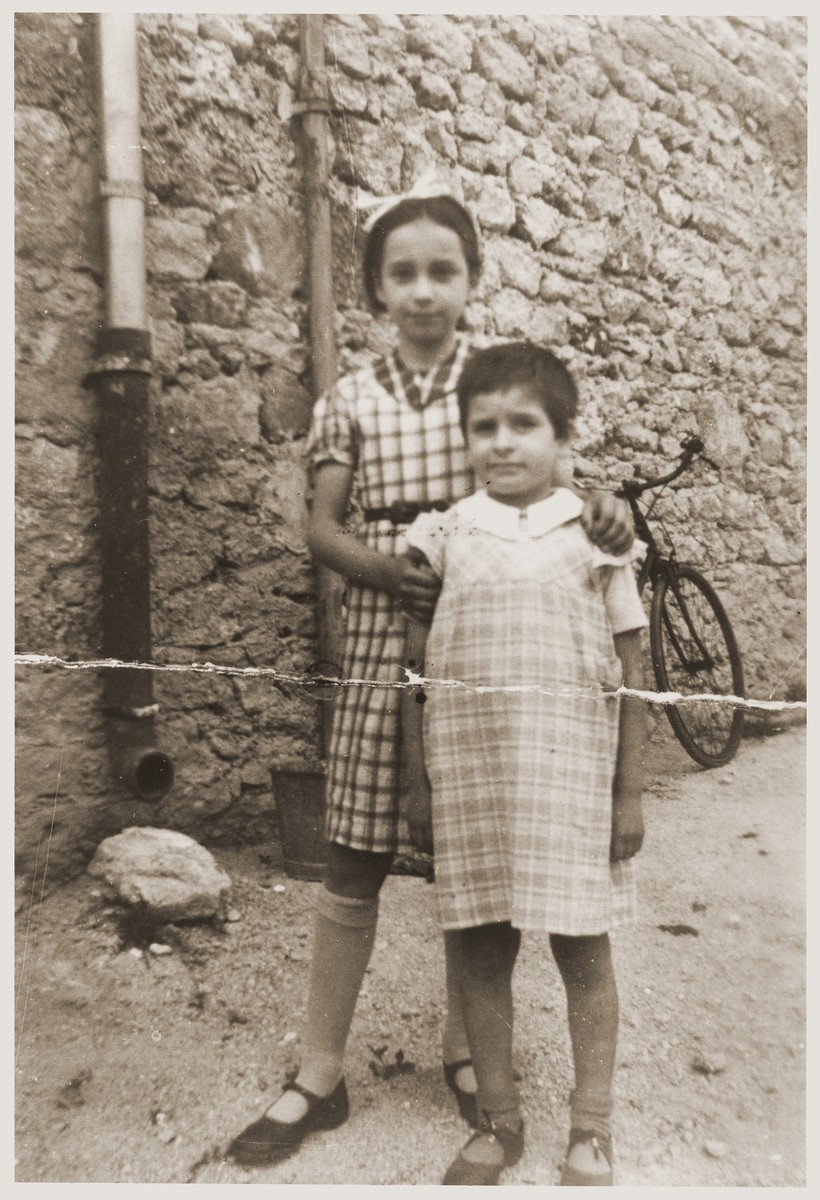 Eva and Rivka Tuchsznajder pose outside the home in St. Jean-de-Vedas, where they were taken after their release from the Rivesaltes internment camp.
