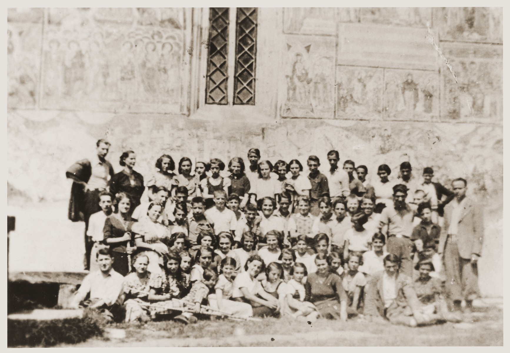 Group portrait of students from the Balan Girls Gymnasium taken while on an outing to the St. Stephen monastery in Moldavia.  Fritzi Brender stands in the top row, fourth from the right.