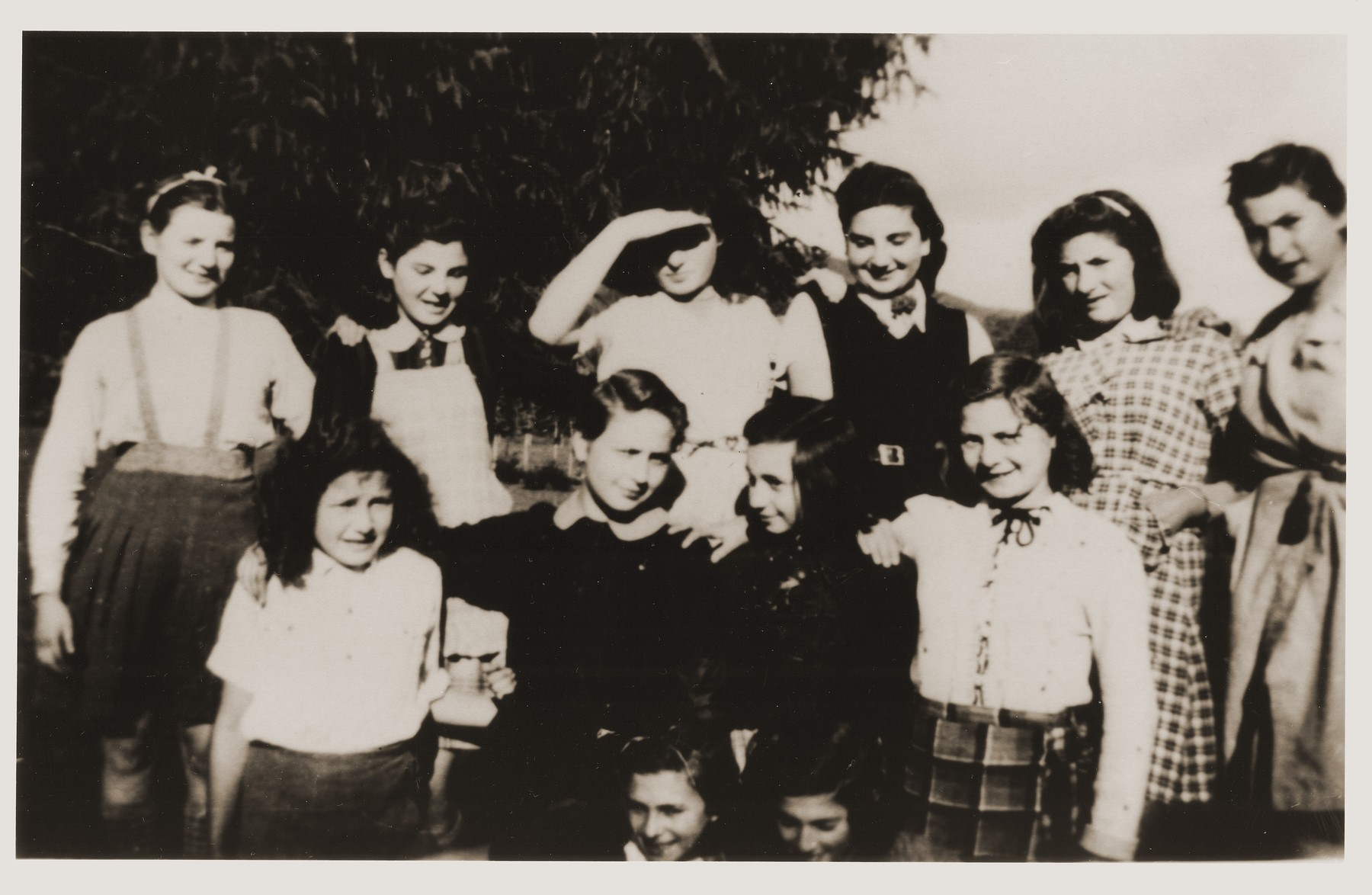 Group portrait of Jewish refugee children, who had been released from French internment camps, at the OSE [Oeuvre de secours aux enfants] home for religious girls at Le Couret.  Pictured are Dora, Lotte Michel, Hermine, Hanna Moses, Edith Rosenthal, Lydie, Litzi Menkes, Eva Tuchsznajder, Annie Fisher, Sophie and Inge.