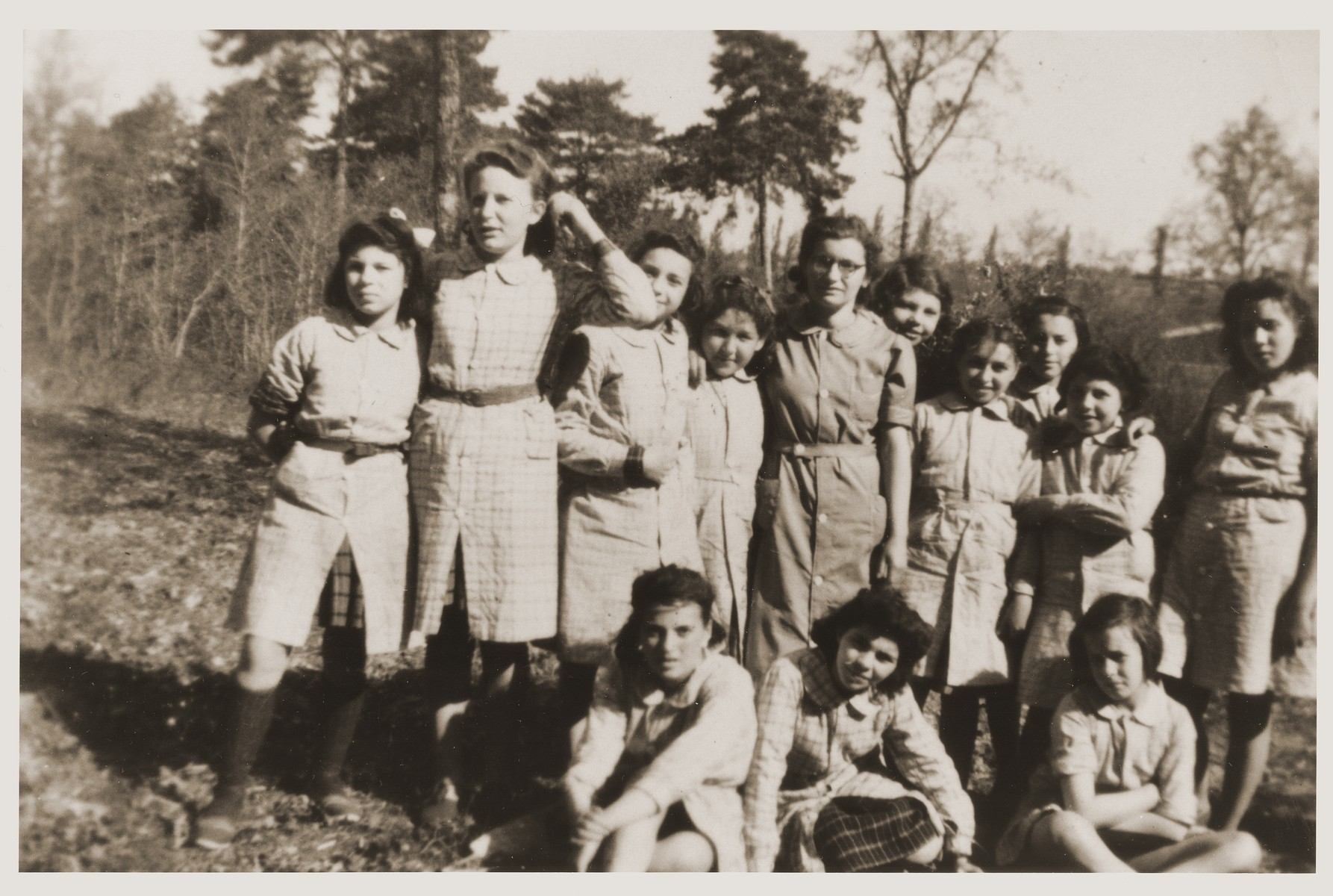 Group portrait of Jewish girls who are living in hiding at the children's home in Le Coudray.  Among those pictured (with their aliases) are: Eva Tuchsznajder (Yvonne Drapier), Helene Klizman (Gerlier), Fanny Lamberger (Lambert), and Irene Burenstein (Burin).  Their counselor was Renee Vigneron.
