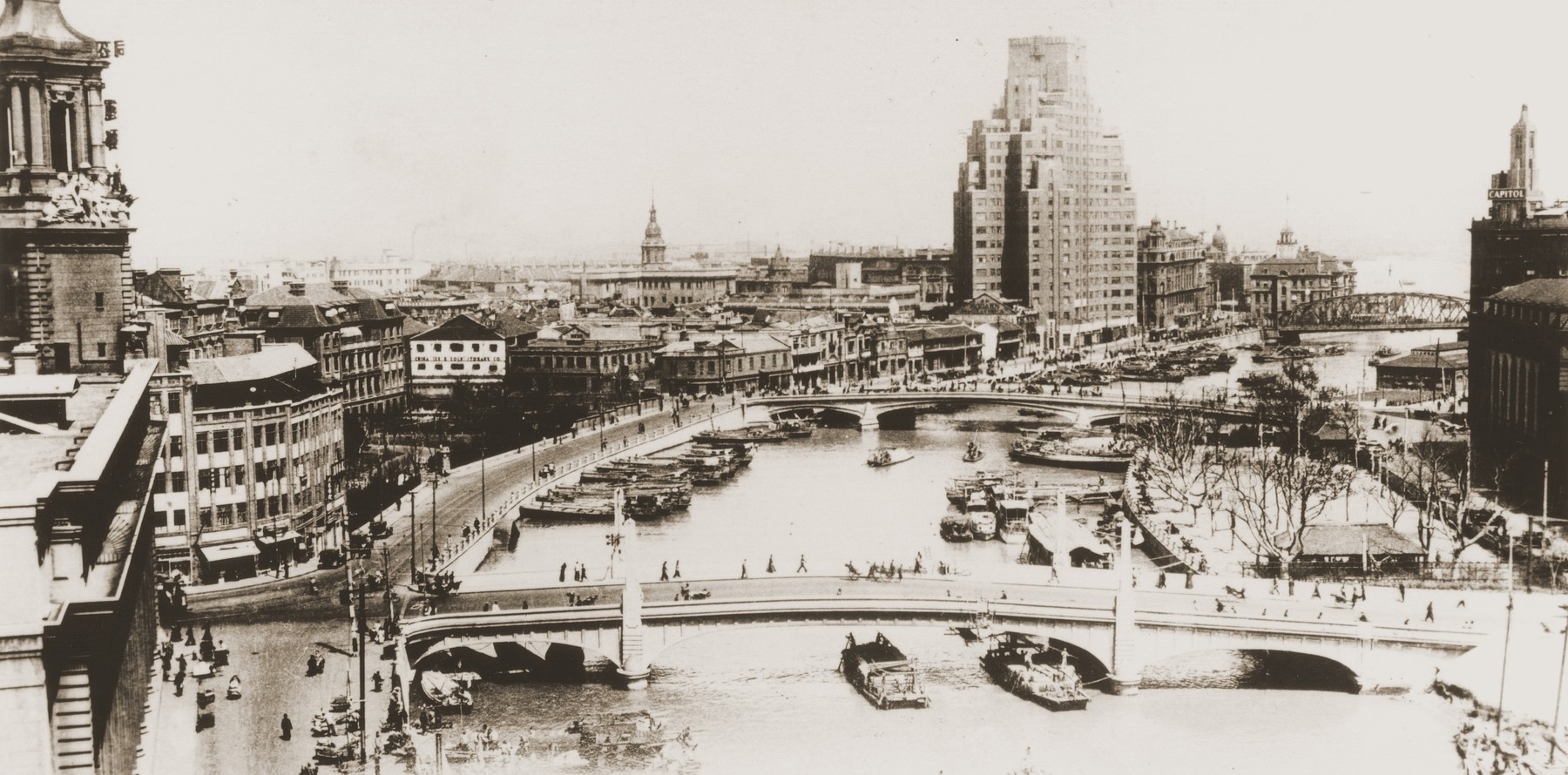 Picture postcard of the Soochow Creek looking towards the Mansions Building on the Bund.