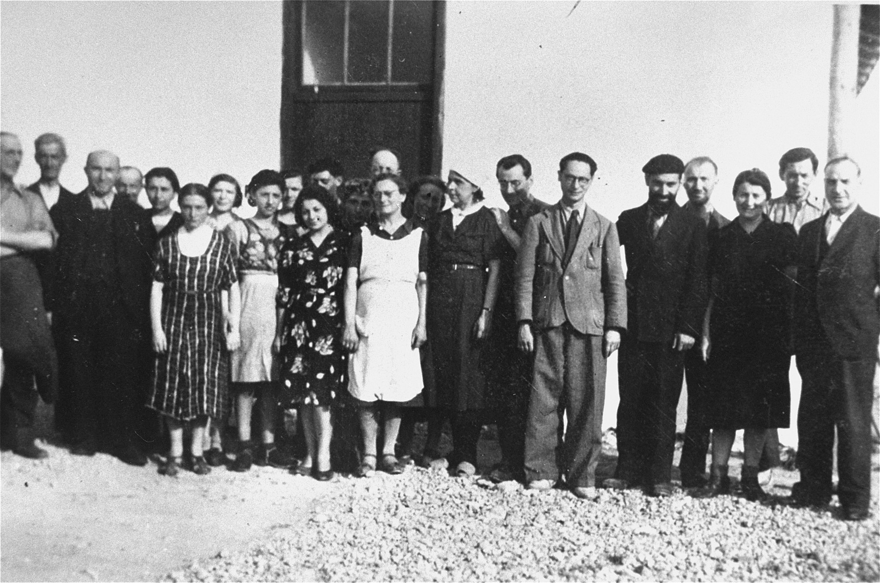 "Members of ""Le Comite,"" a group of prisoners who aided the OSE in Rivesaltes.  Those pictured include Erwin Heilbronner (fourth from right) and his wife Flora Heilbronner (fifth from left)."