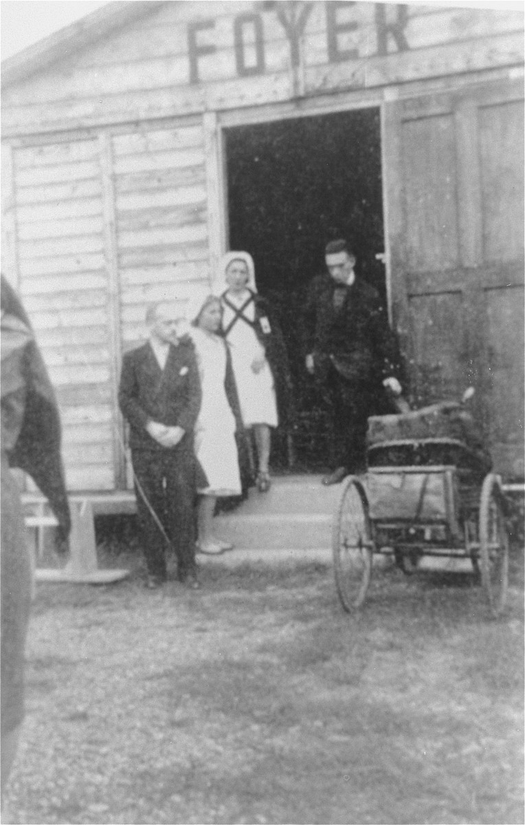 French Red Cross nurses stand in front of the CIMADE home in the Recebedou internment camp in the unoccupied zone of France.  CIMADE (Commission inter-Mouvements aupres des Evacues), was a French Protestant youth movement which helped to organize relief efforts in French internment camps, and escape routes for the persecuted to Spain and Switzerland.