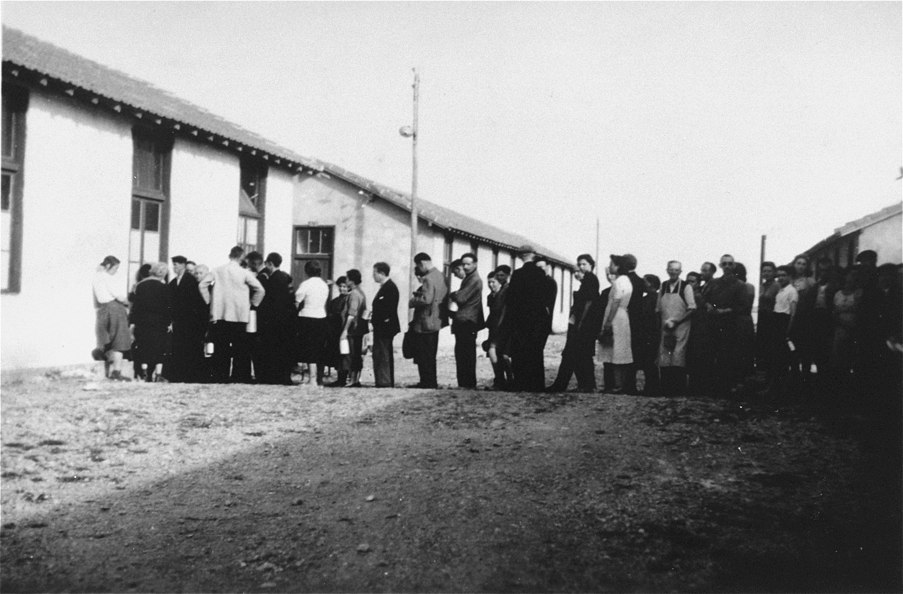 Prisoners in Rivesaltes on line for food distributed by relief agencies.