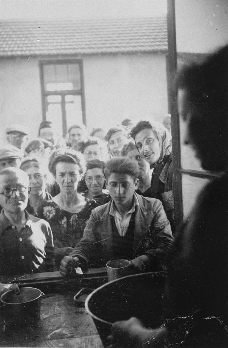 Prisoners in Rivesaltes line up at a food distribution point.