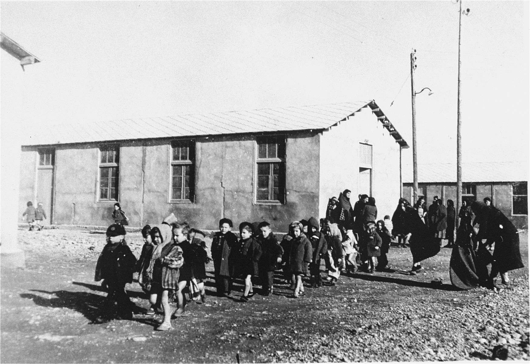 Children in the Rivesaltes transit camp under the care of the OSE.  The little girl directly in the middle of the photo is Lucie Ragin.