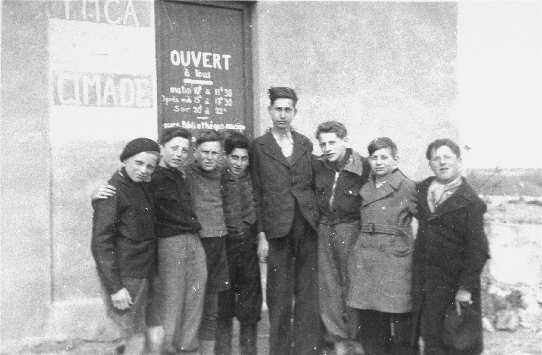 Members of a boy scout troop organized by Simone Weil in the Rivesaltes transit camp.  Second from right is Werner Heilbronner (now Daniel Barnea).  Fourth from right is his brother Kurt (now Uri) Heilbronner.