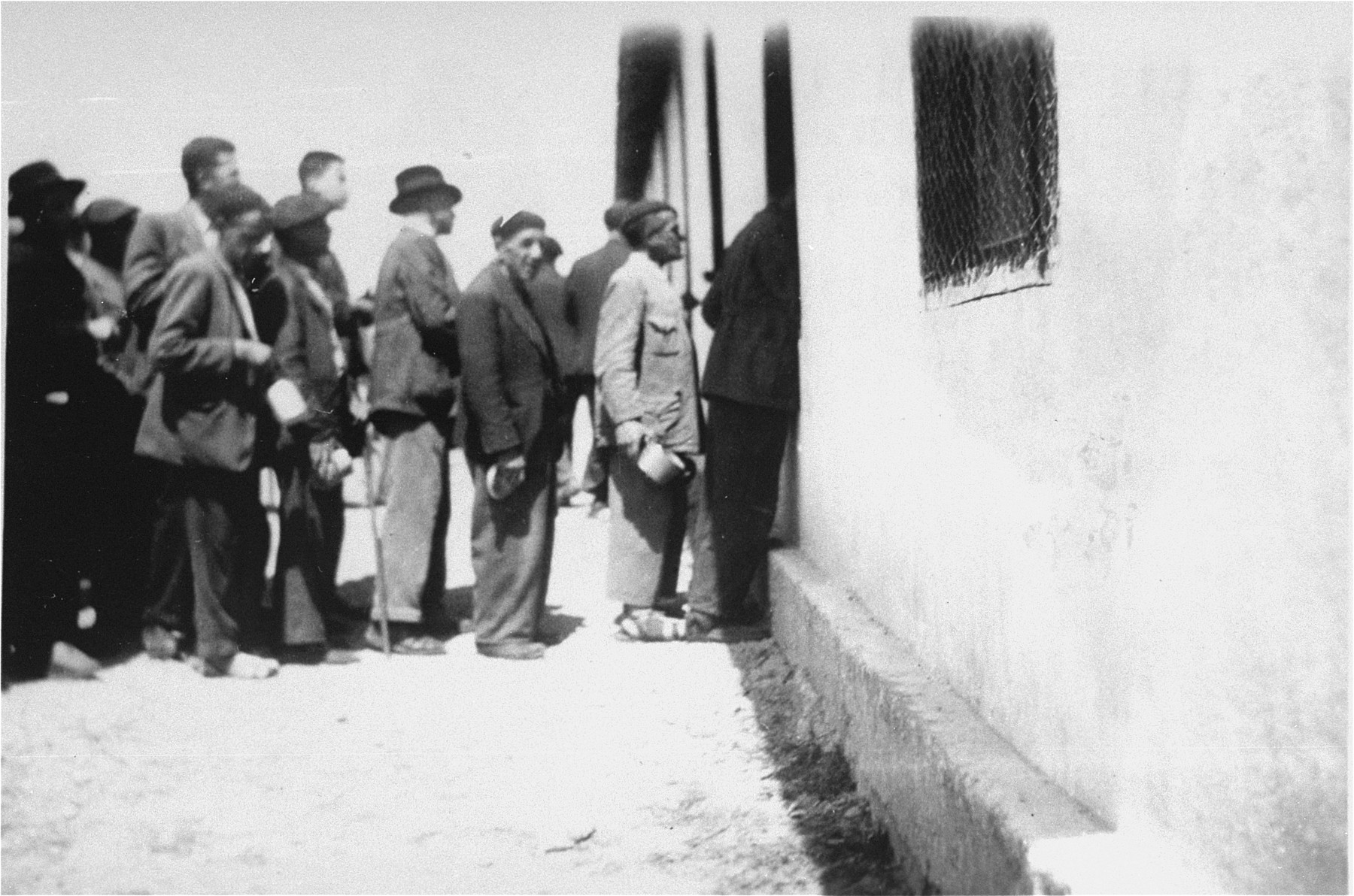 Prisoners in Rivesaltes on line for rations.