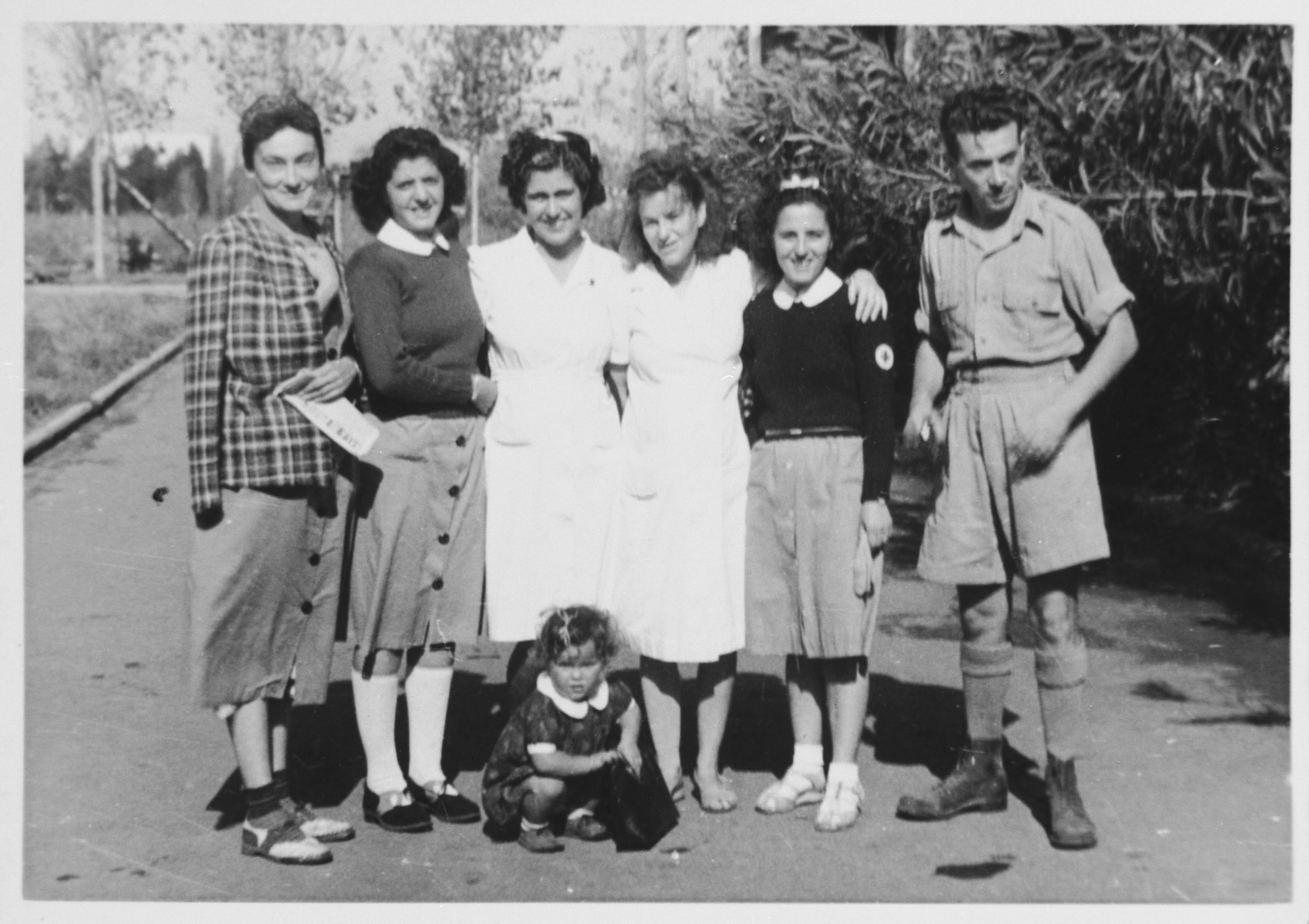 The medical staff of the Cinecitta displaced persons camp.  Mordko Tenenbaum is on the far right.  Ursula Tenenbaum is third from the right, and their daughter Katia, is squatting in the center.