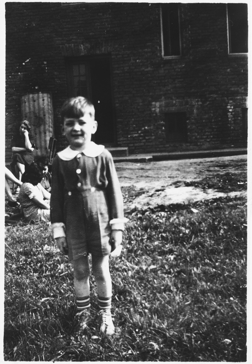 A young Jewish boy poses outside in the Rzeszow ghetto.  Pictured is Roman Haar prior to going into hiding.