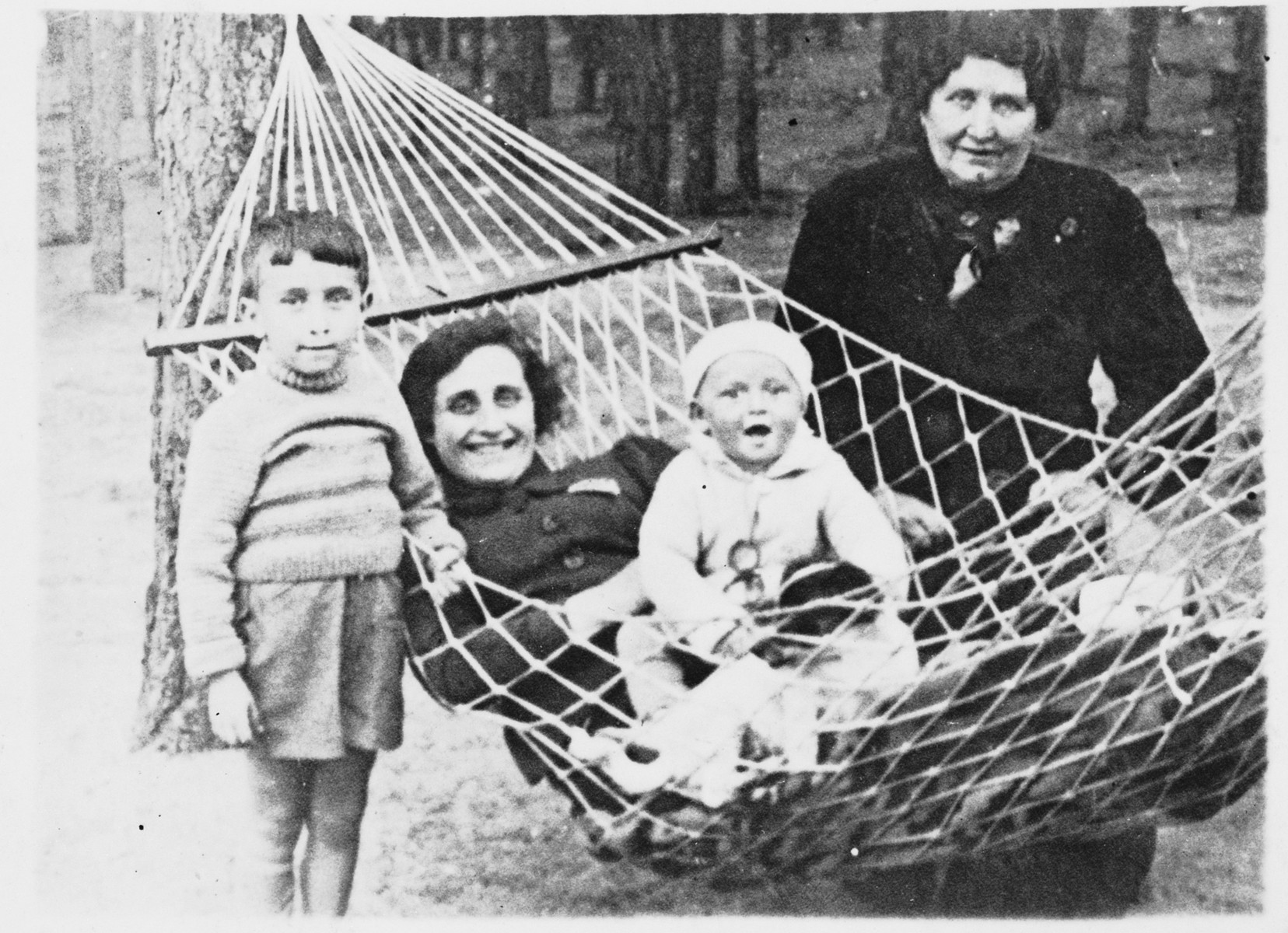 Dvorah Rubin (the donor's grandmother) poses next to a hammock with her daughter and grandchildren.