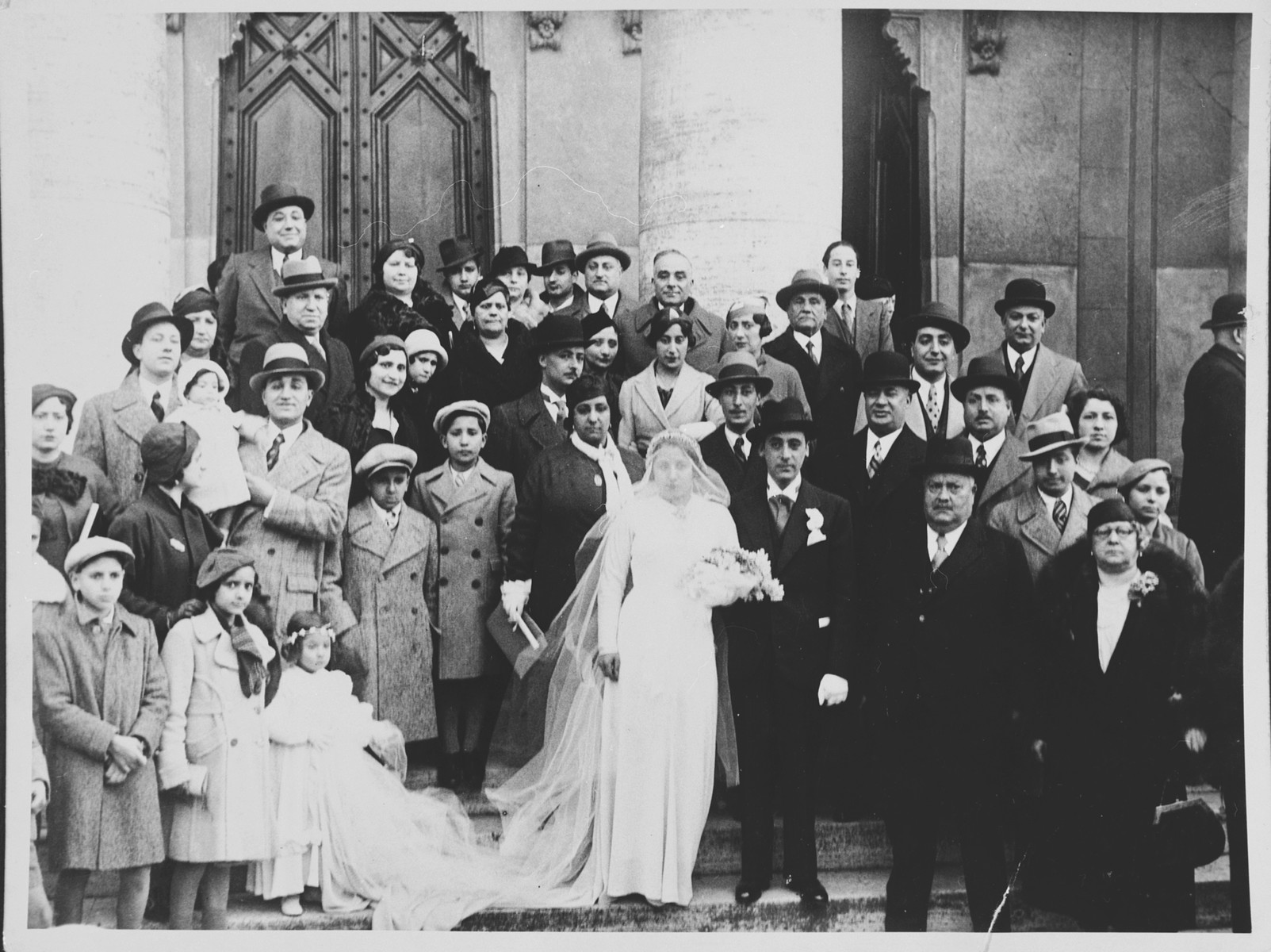 Wedding portrait of Wilhelma Spagnoletto and Mario Abbina.  On the left with the baby is Aurelio Spagnoletto and near him is Ezio Spizzichino.