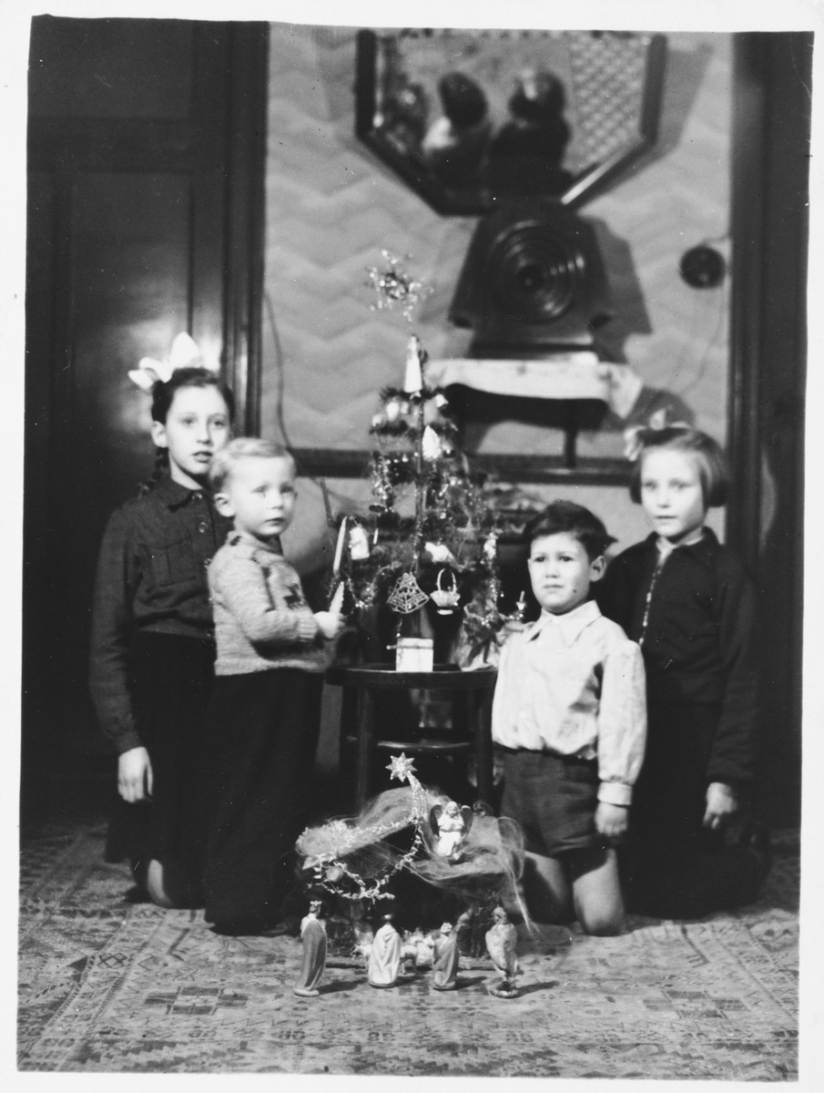 Norbert Obstfeld celebrates Christmas at the home of his rescuers, Raymond Verhage and Julia Verhage-Leenknecht.  Pictured from left to right are: Raymonda Verhage, Etienne Delobelle, Norbert Obstfeld and Jacqueline da Cunha (Norbert's cousin).