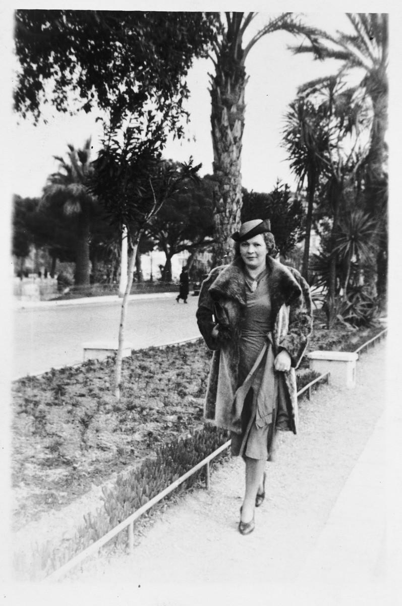 Trimette Langer, an Austrian Jewish refugee, walks along a tree-lined street in Nice.
