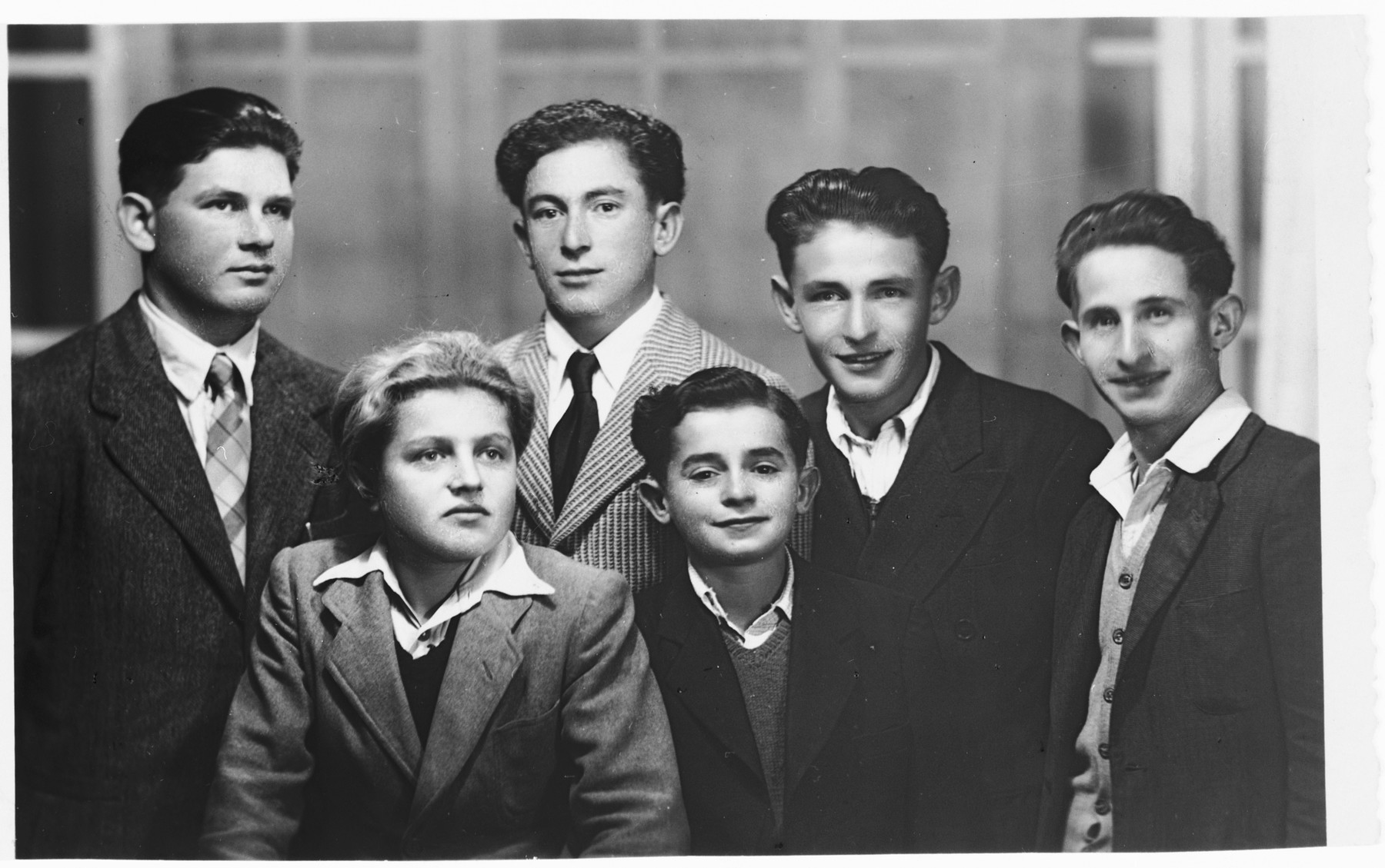 Group portrait of Jewish youth at the Selvino Youth Aliyah children's home.  Dov Zugman is pictured on the far right.   Pictured in the front center is Motel Hostyk.  Standing back on the left is Avramchik and Mendel Rosenkrantz.