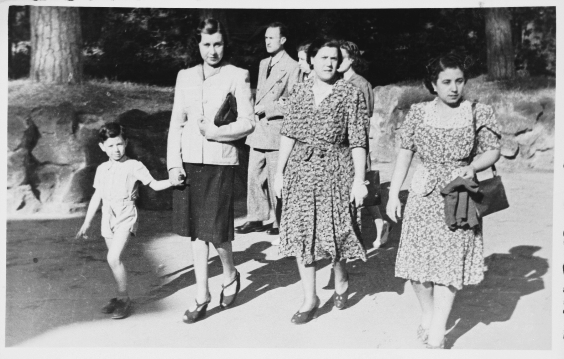 Cristina Frascatani  walks down the street with a group of Jewish freinds including two whom she hid during the war.  From left to right are Giancarlo Spizzichino holding the hand of Irma Pesci.  Cristina Frascatani (Giancarlo's rescuer) is in the center.  Wilhelma Spagnoletto, the aunt of Giancarlo, is on the right.    Wilhelma was also hidden by Cristina Frascatani, as was her husband, Mario Abbina.