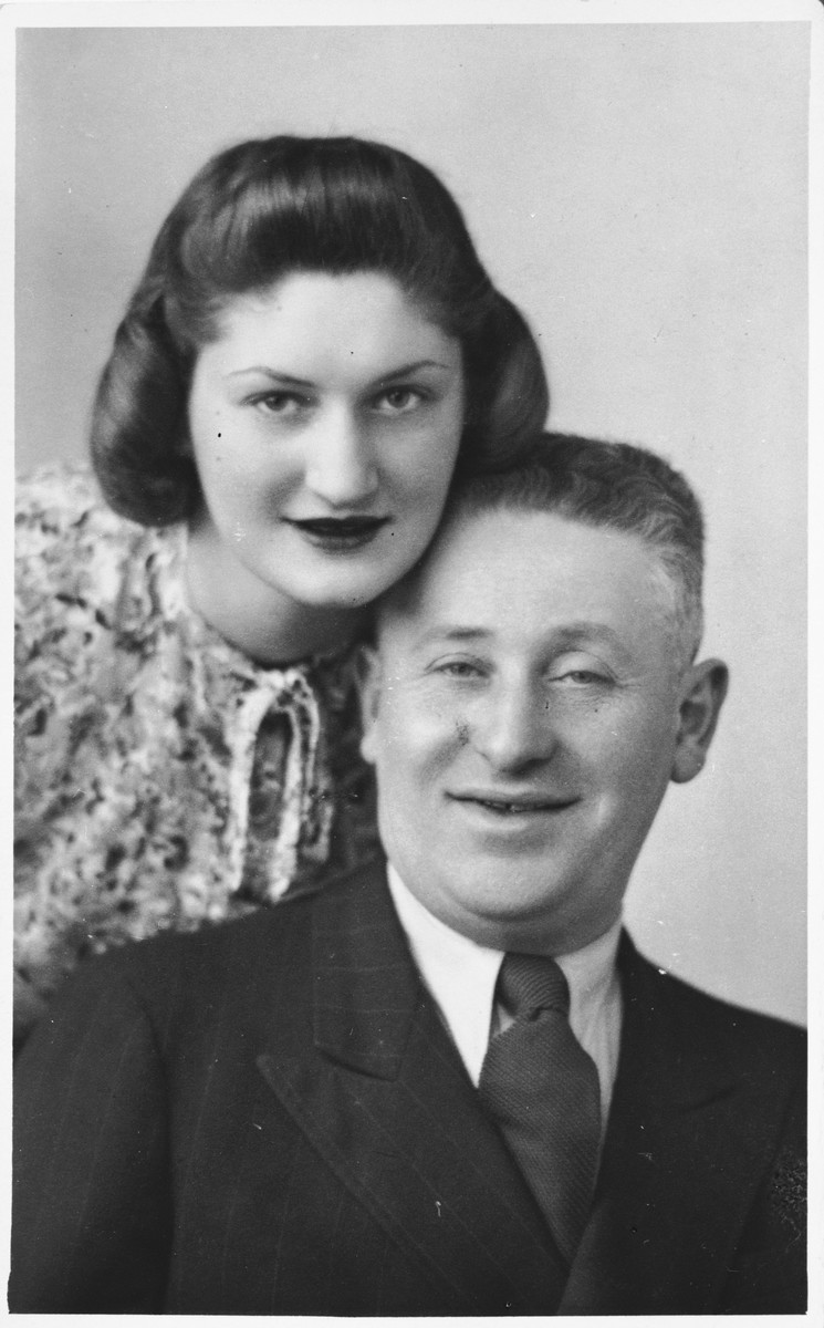 Austrian Jewish swimming champion, Ruth Langer, poses with her father, Wilhelm Langer.  The photograph was taken in England on the occasion of Wilhelm's visit from Paris.