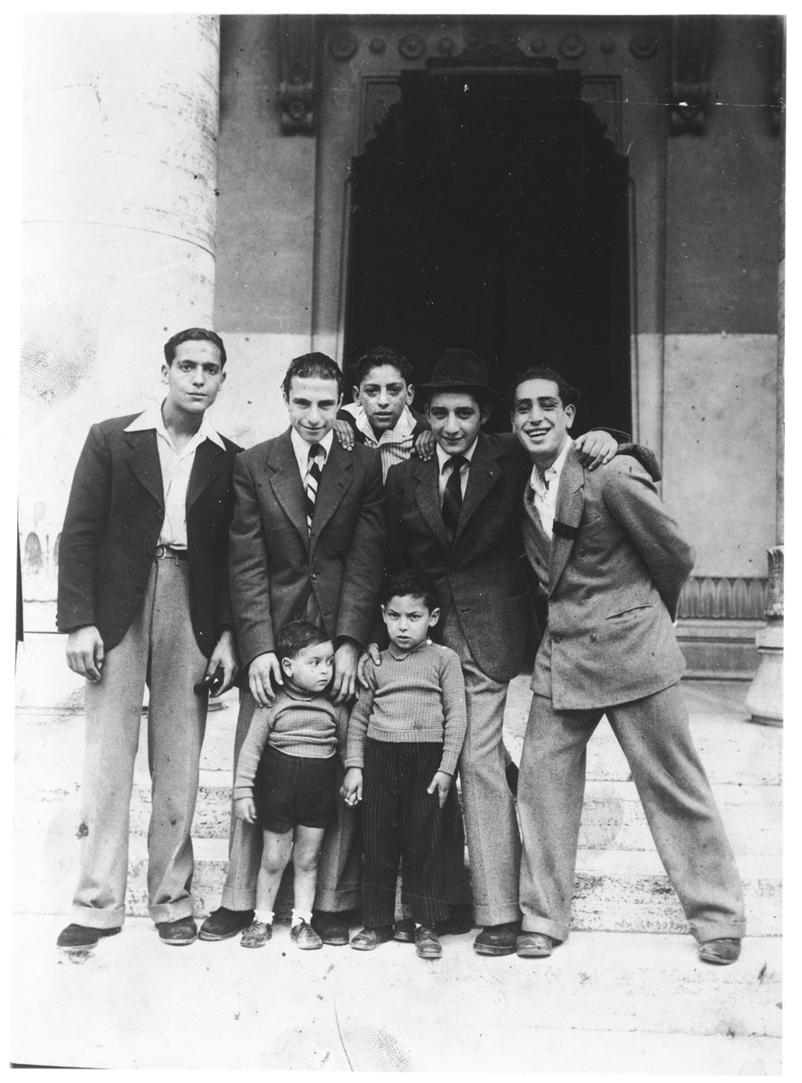 A group of young men and children stand outside the synagogue in Rome.