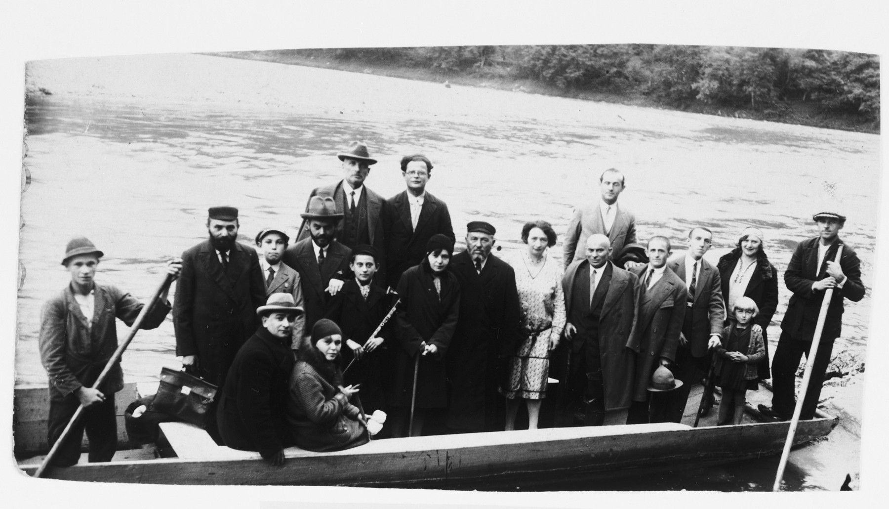 A group of Jewish friends goes on a boat excursion while vacationing in Otwock.  Lila's maternal grandfather Papier is in the center.