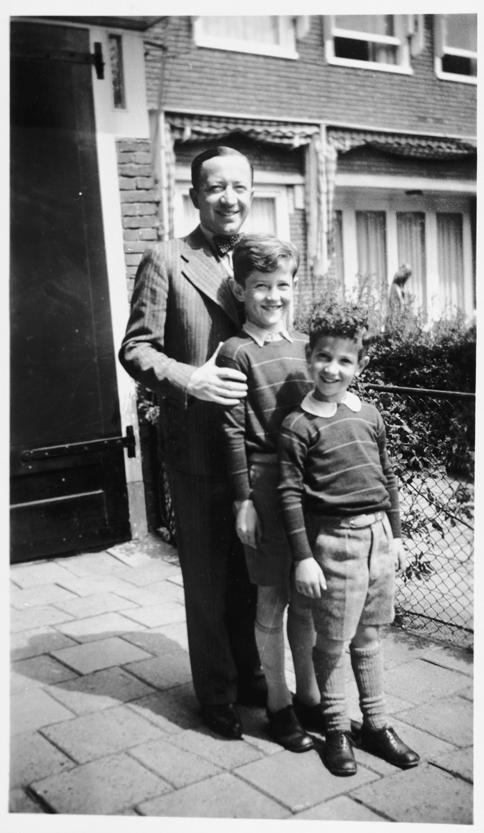 A Dutch Jewish father poses with his two sons outside their home in Amsterdam.  Pictured back to front are Paul, Robert and Hans Hendrix.